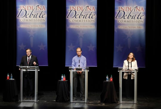 Democratic Sen. Joe Donnelly, Republican former state Rep. Mike Braun and Libertarian Lucy Brenton, from left, participate in a U.S. Senate Debate, Tuesday, Oct. 30, 2018, in Indianapolis.