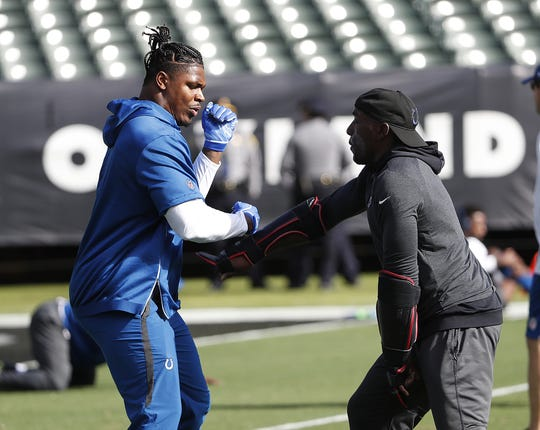 """""""I feel like a lot of guys aren't being taught right,"""" says Mathis, seen here working with Colts defensive tackle Al-Quadin Muhammad before Sunday's game in Oakland."""