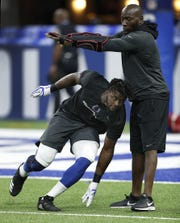 Indianapolis Colts defensive end Kemoko Turay (57) works with Robert Mathis before the start of their game against the Cincinnati Bengals at Lucas Oil Stadium on Sept. 9, 2018.