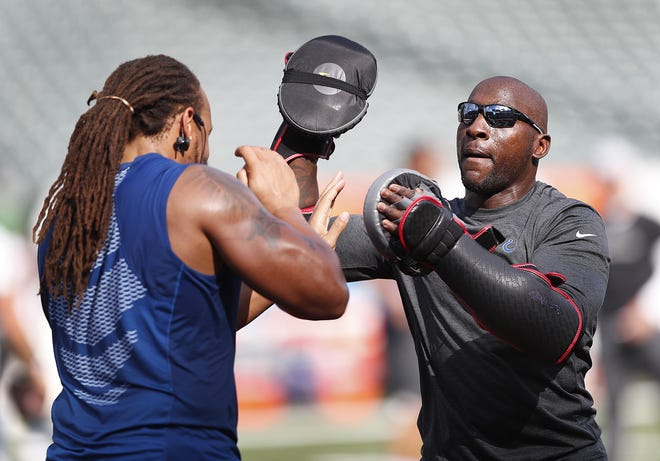 """""""This is who I am,"""" says Robert Mathis, here working with Colts defensive end Jabaal Sheard. """"I'm a football guy. That's hard to explain. But I love being here, teaching pass-rush and how to body-slam quarterbacks."""""""