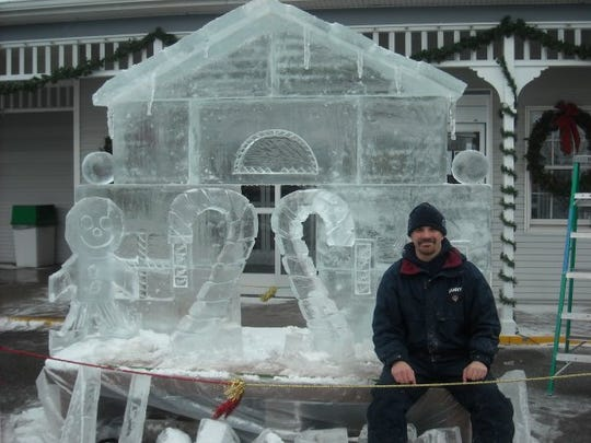 Danny Bloss with ice gingerbread house, 3000 pounds, sculpture, Shipshewana Ice Festival, 2012.
