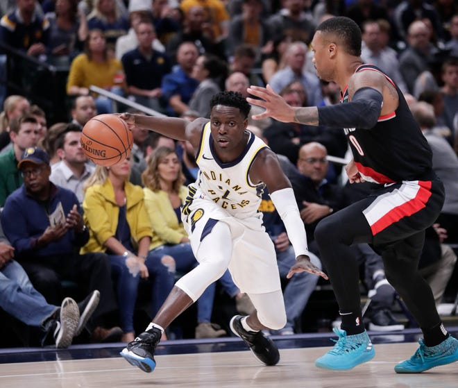 Indiana Pacers guard Darren Collison (2) drives on Portland Trail Blazers guard Damian Lillard (0) during the first half of an NBA basketball game in Indianapolis,