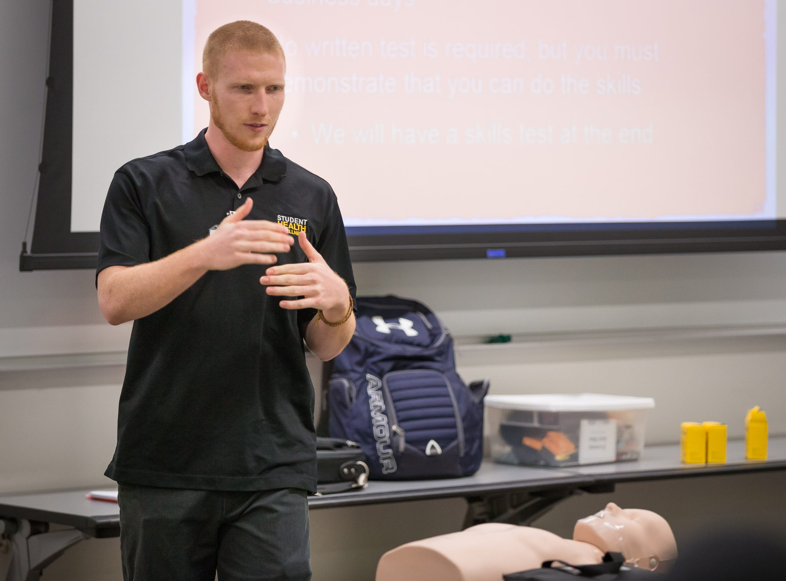 UI senior Dakota Fix addresses a classroom of UI students on CPR methods and best practices at the UI Campus Recreation & Wellness Center on Monday, October 29, 2018.