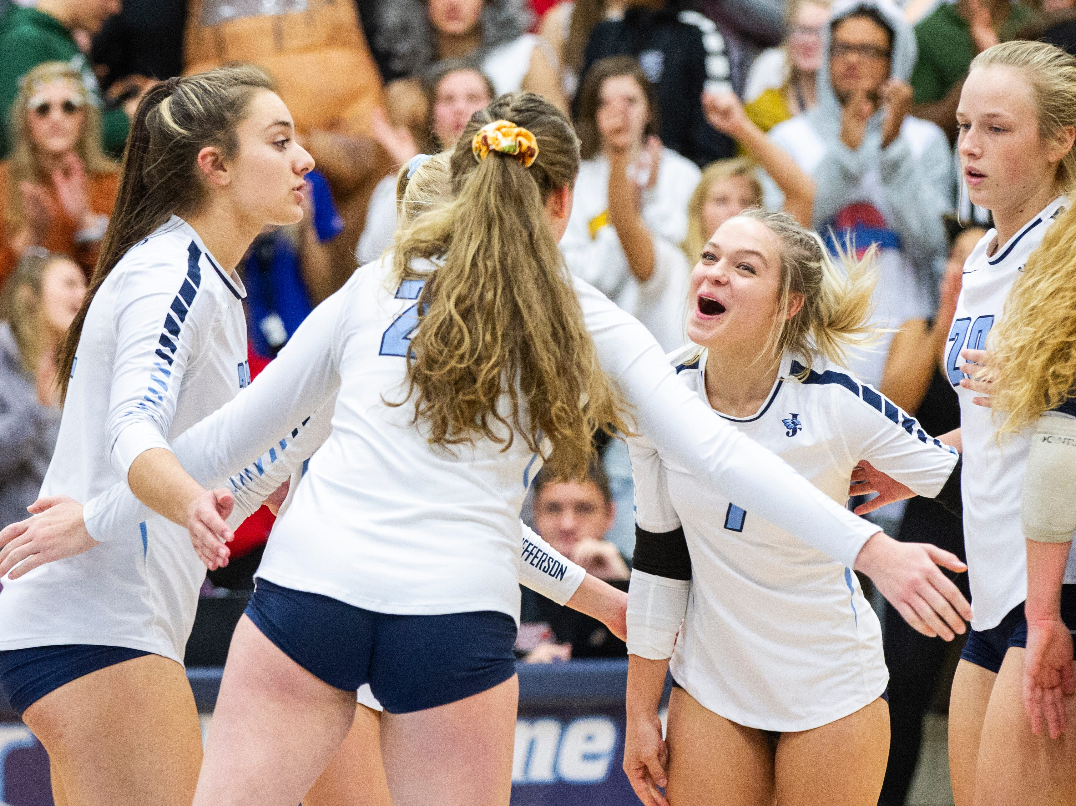 Cedar Rapids Jefferson's Maggie Peters (18) Maddy Baxter (3) Kaylee Donner (10) Sydney Kloubec (21) and Allie Krousie (7) celebrate a point during a Class 5A volleyball regional final game on Monday, Oct. 29, 2018, at Jefferson High School in Cedar Rapids.
