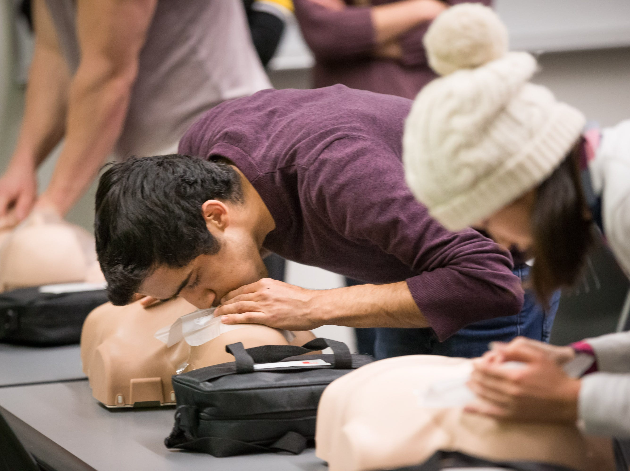 UI grad student Parth Kotak practices CPR breaths into a practice dummy at the UI Campus Recreation & Wellness Center on Monday, October 29, 2018.
