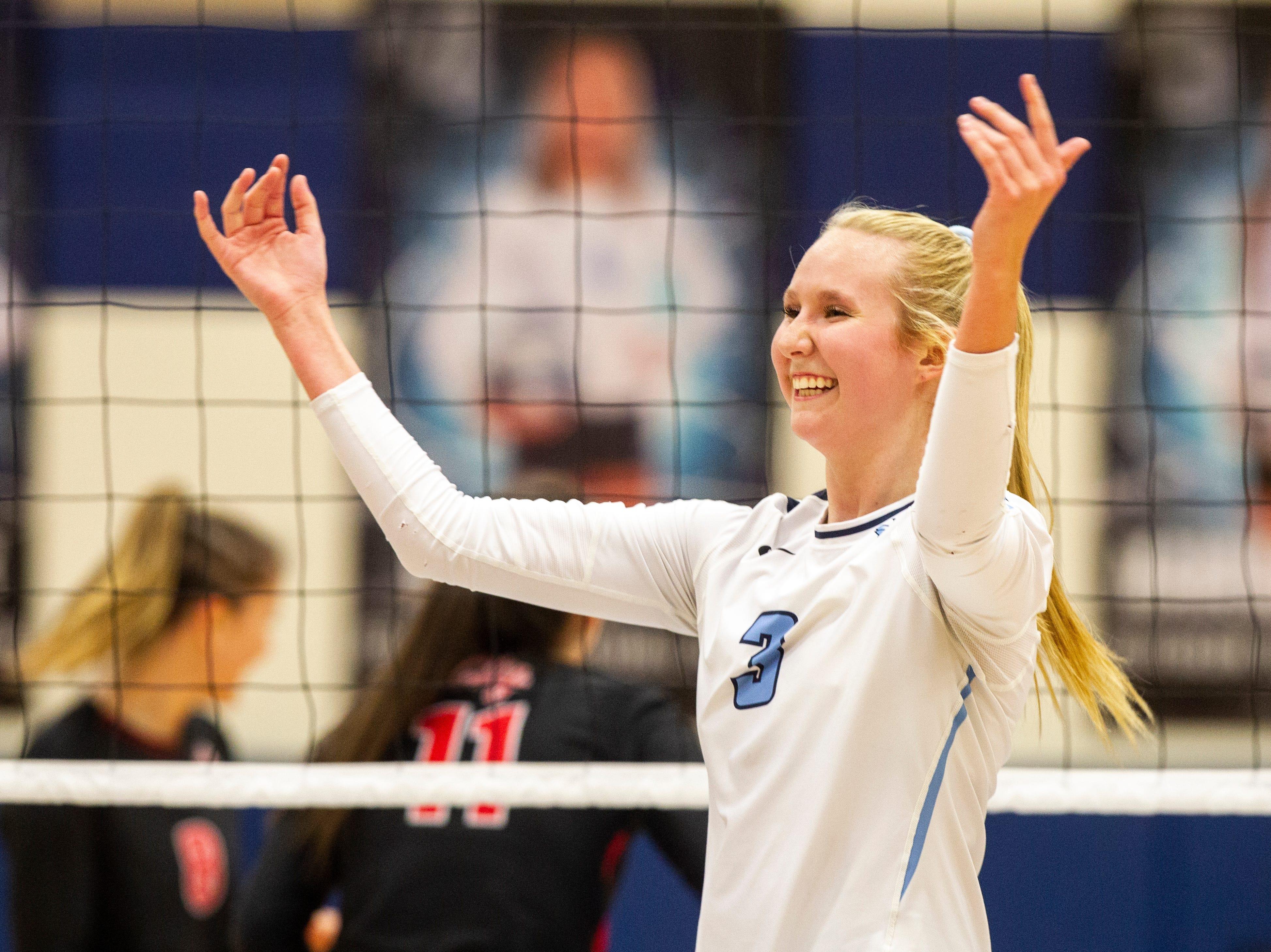 Cedar Rapids Jefferson's Maddy Baxter (3) celebrates a point during a Class 5A volleyball regional final game on Monday, Oct. 29, 2018, at Jefferson High School in Cedar Rapids.