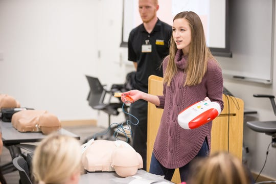 UI senior Morgan Zuidema exhibits automated external defibrillator (AED) operations on a practice dummy to a classroom of UI students at the UI Campus Recreation & Wellness Center on Monday, October 29, 2018.