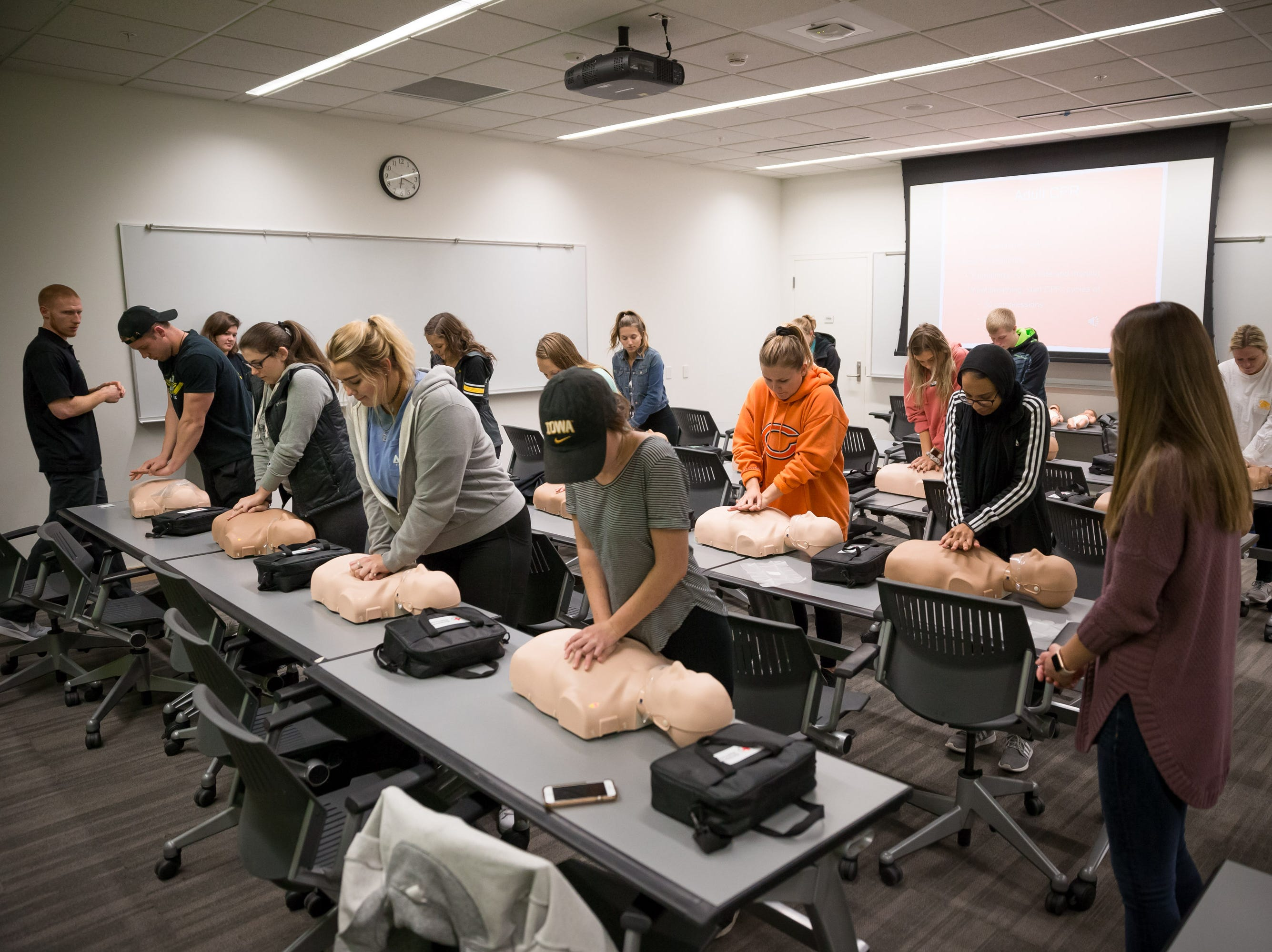 UI students practice CPR compressions on test dummies at the UI Campus Recreation & Wellness Center on Monday, October 29, 2018. Bill Adams/Freelance