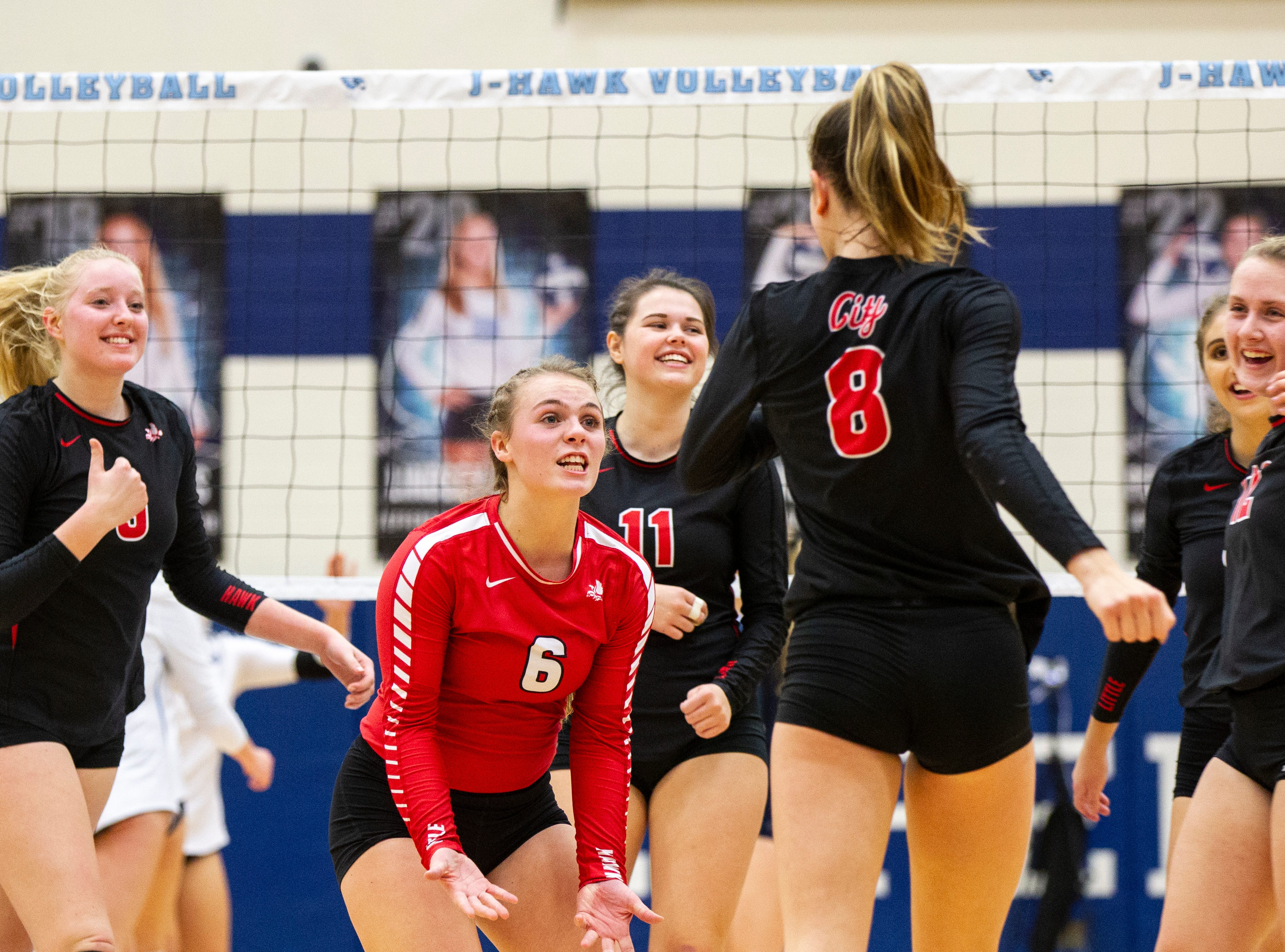 Iowa City High's Brooke Bormann (6) celebrates with teammates during a Class 5A volleyball regional final game on Monday, Oct. 29, 2018, at Jefferson High School in Cedar Rapids.