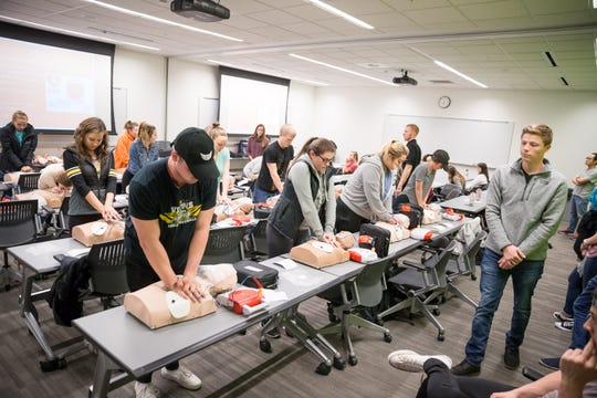 UI students practice CPR coupled with automated external defibrillator (AED) components on test dummies at the UI Campus Recreation & Wellness Center on Monday, October 29, 2018.