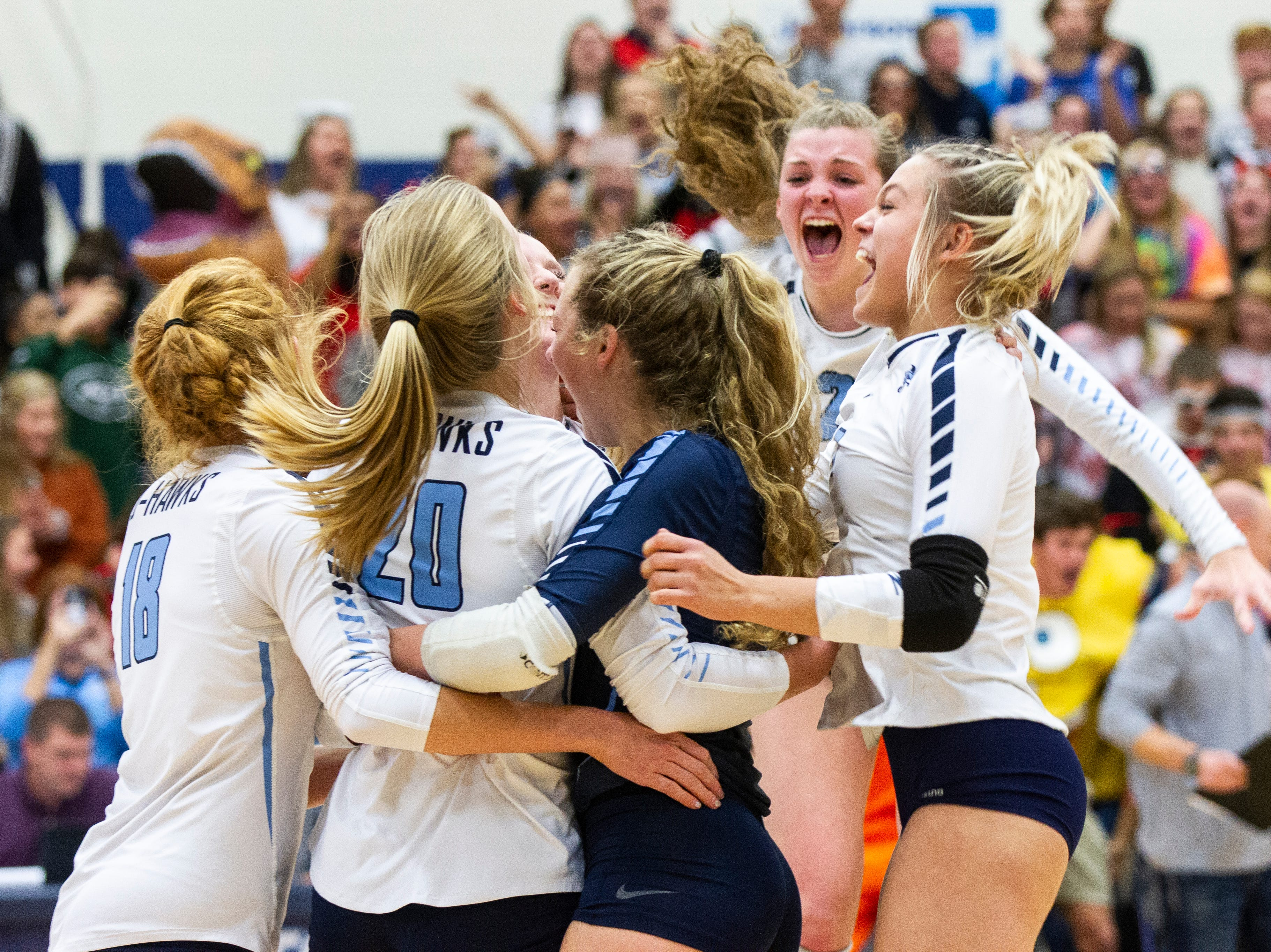 Cedar Rapids Jefferson's Maggie Peters (18) Maddy Baxter (3) Kaylee Donner (10) Sydney Kloubec (21) and Allie Krousie (7) celebrate winning a final point after a Class 5A volleyball regional final game on Monday, Oct. 29, 2018, at Jefferson High School in Cedar Rapids.