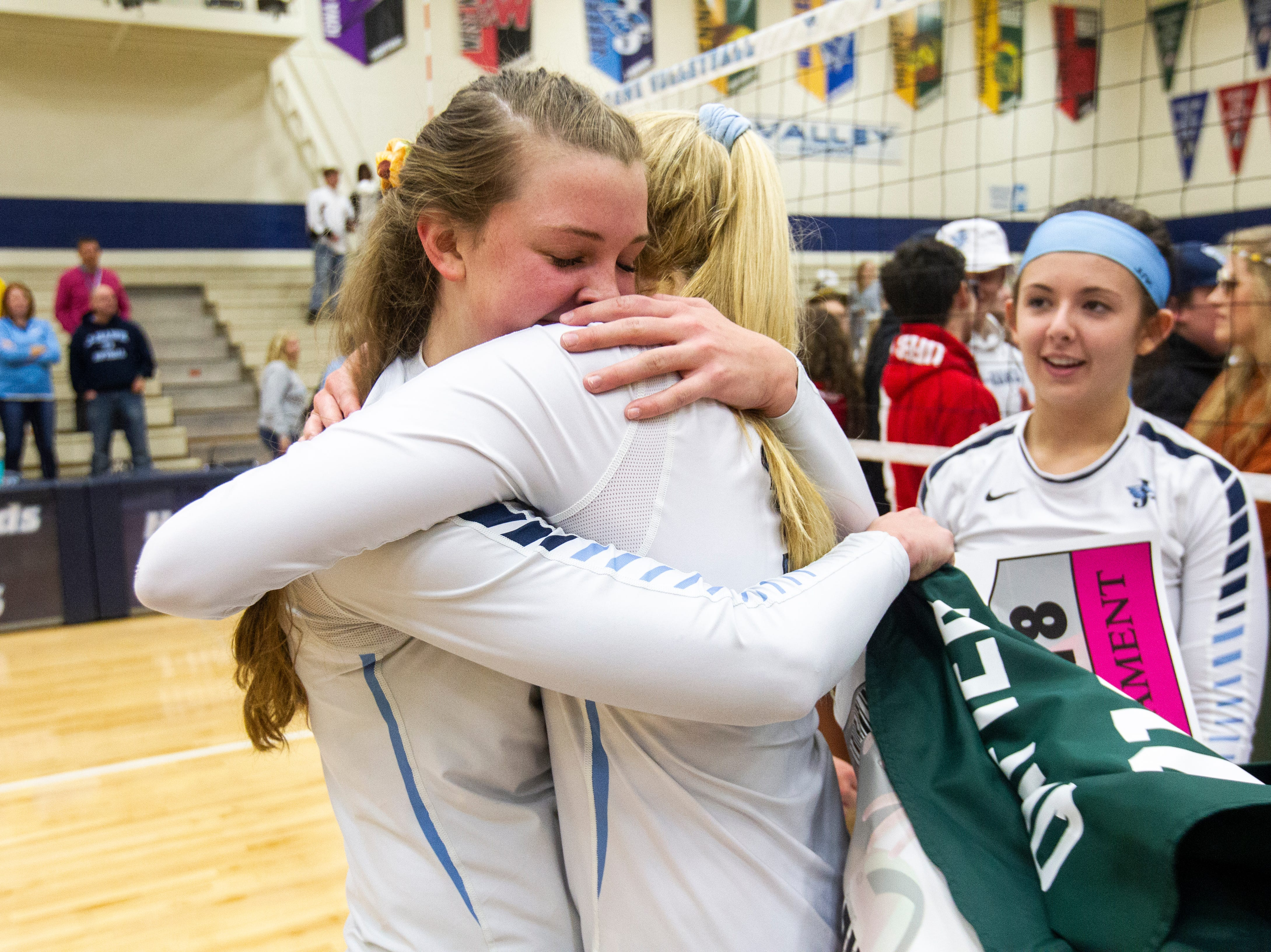 Cedar Rapids Jefferson's Sydney Kloubec (left) is embraced by Maddy Baxter after a regional final volleyball game Monday, Oct. 29, 2018, at Jefferson High School in Cedar Rapids.