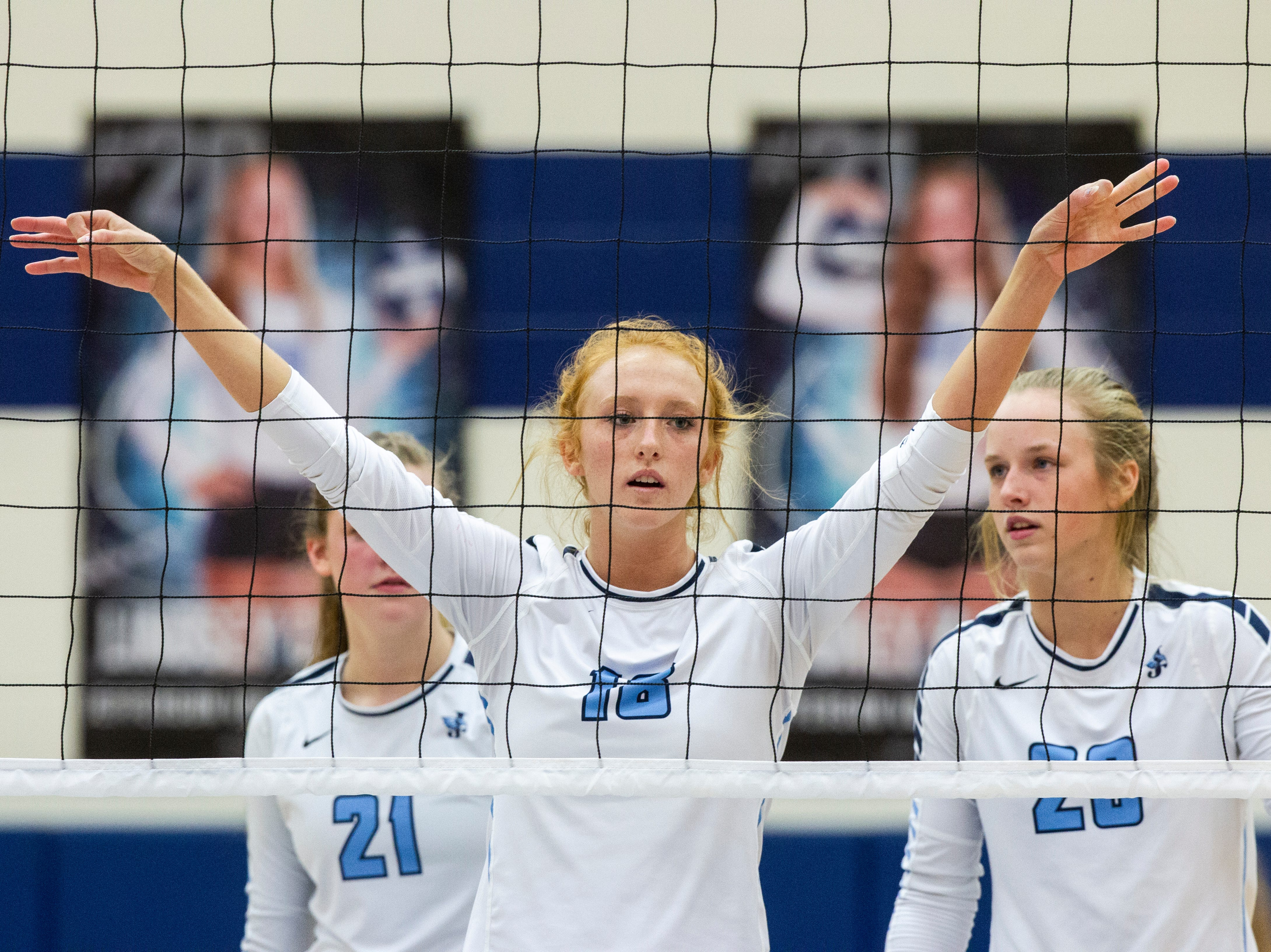 Cedar Rapids Jefferson's Maggie Peters (18) gets her hands up before a serve during a Class 5A volleyball regional final game on Monday, Oct. 29, 2018, at Jefferson High School in Cedar Rapids.