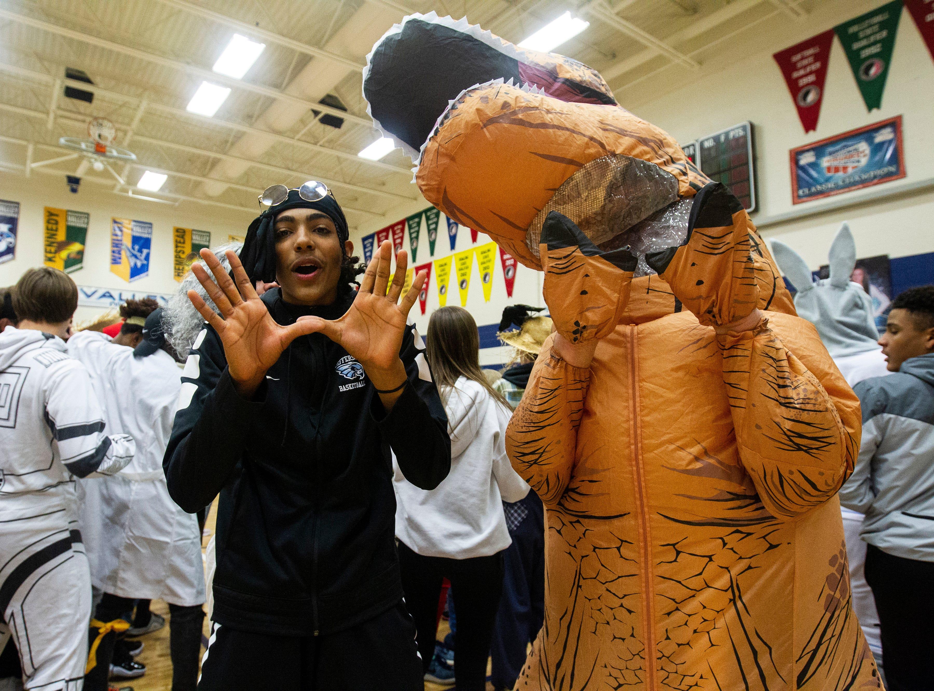 "Cedar Rapids Jefferson fans make a ""W"" with their hands after a Class 5A volleyball regional final game on Monday, Oct. 29, 2018, at Jefferson High School in Cedar Rapids."