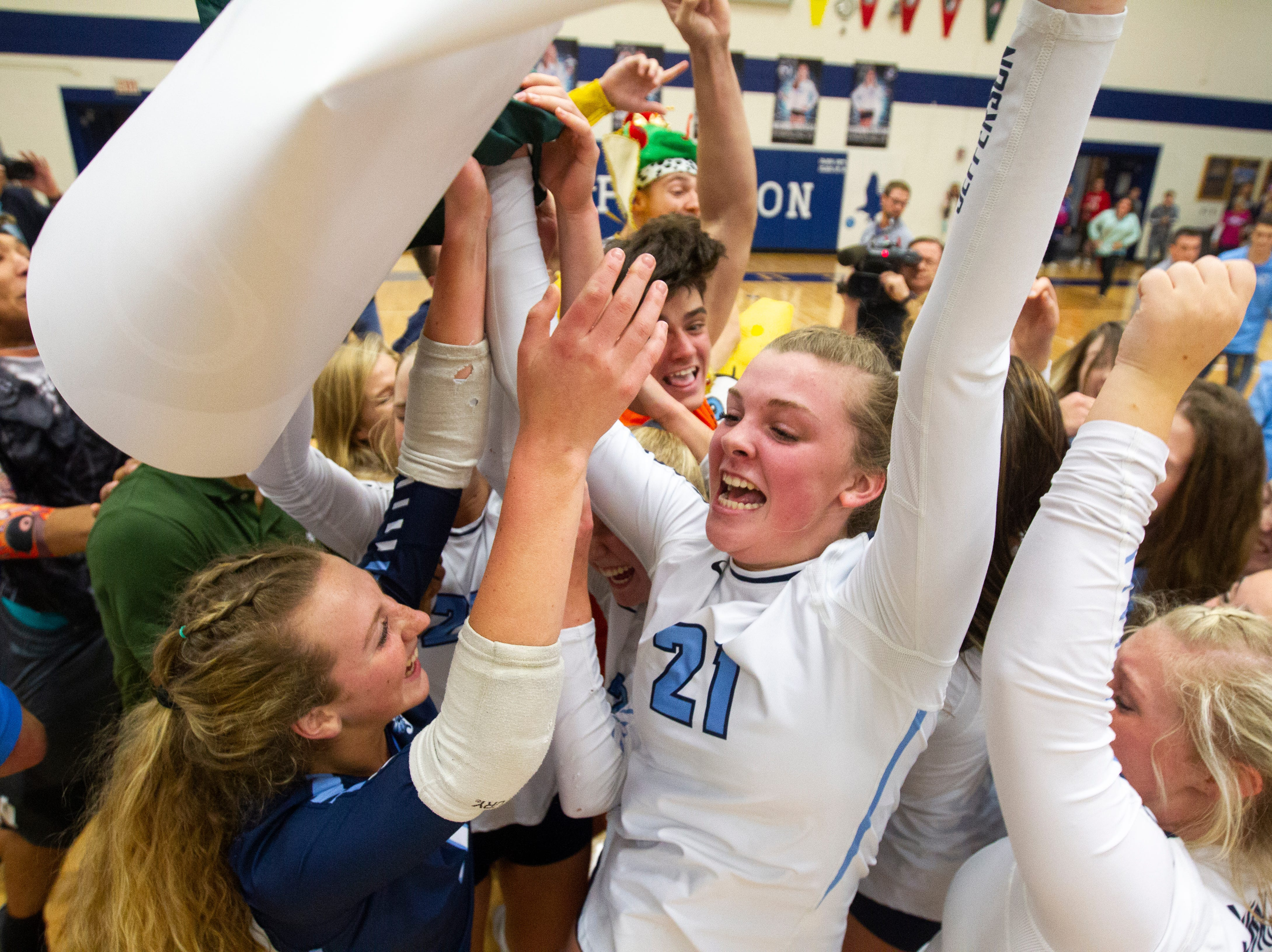 Cedar Rapids Jefferson's Sydney Kloubec (21) celebrates with teammates after a regional final volleyball game Monday, Oct. 29, 2018, at Jefferson High School in Cedar Rapids.