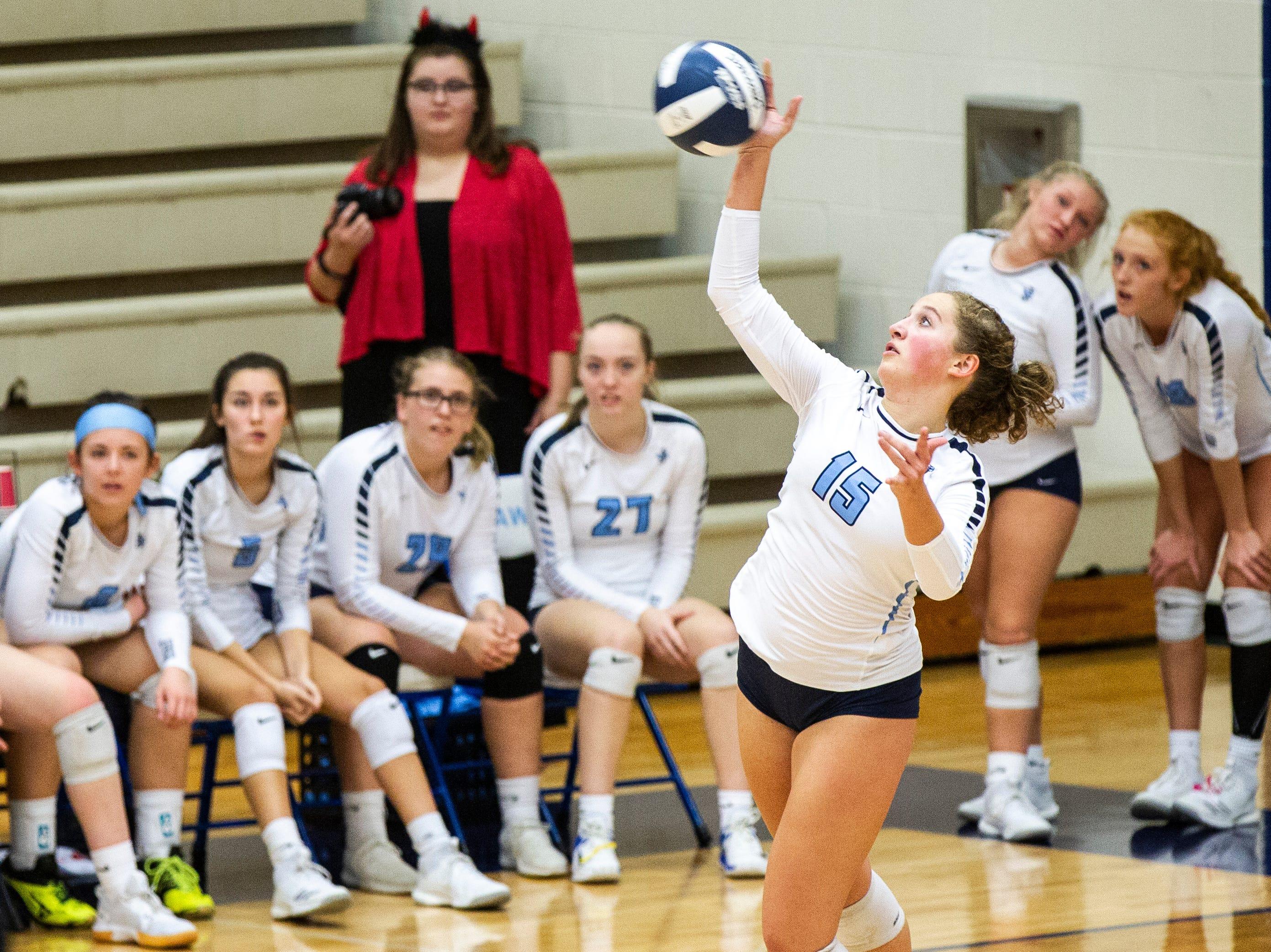 Cedar Rapids Jefferson's Cassidy Boche (11) serves during a Class 5A volleyball regional final game on Monday, Oct. 29, 2018, at Jefferson High School in Cedar Rapids.
