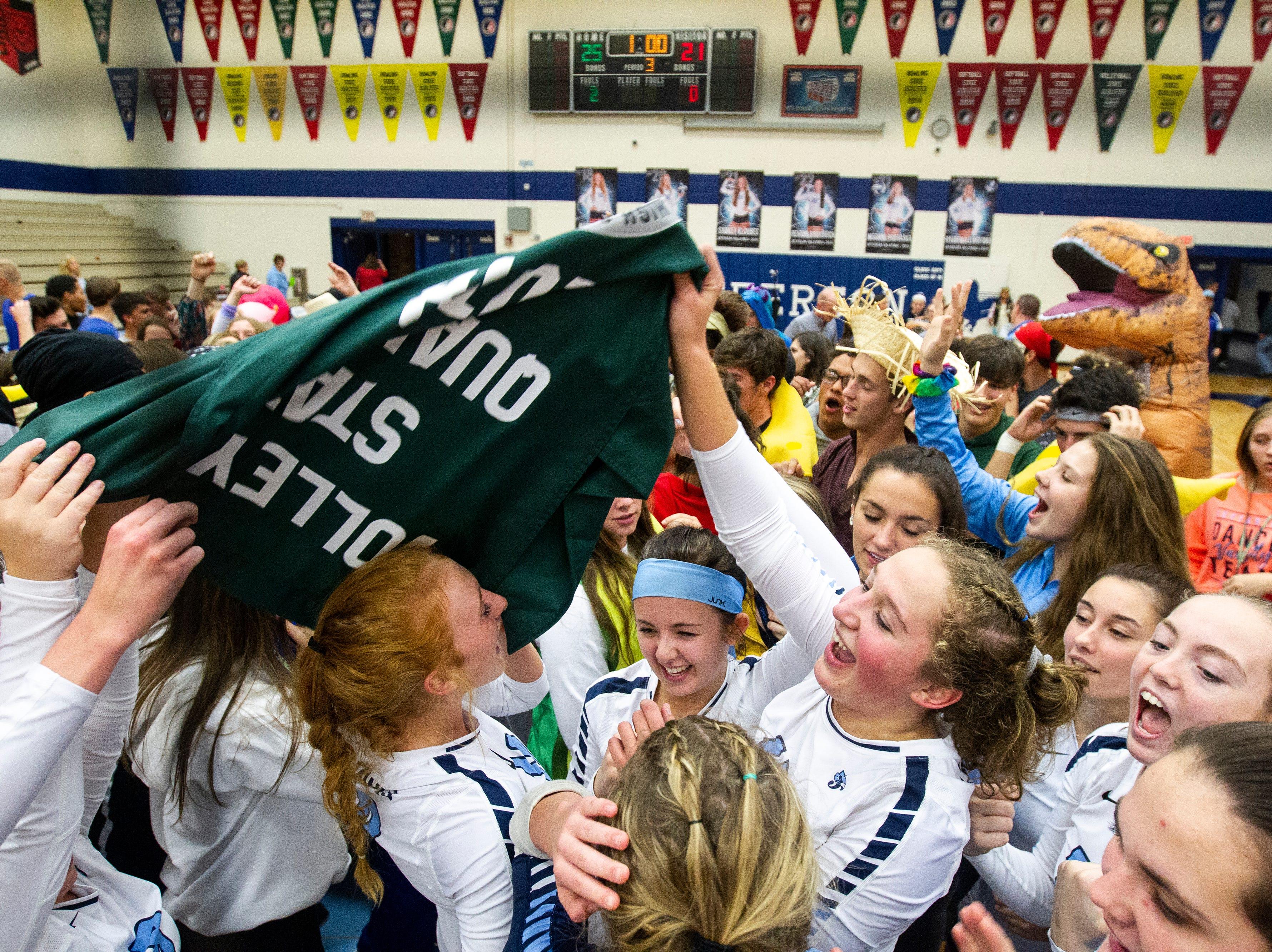 Cedar Rapids Jefferson players celebrate after a Class 5A volleyball regional final game on Monday, Oct. 29, 2018, at Jefferson High School in Cedar Rapids.