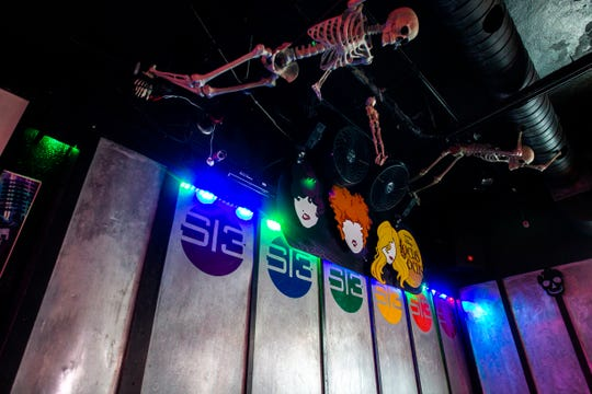 A skeleton hangs from the ceiling over the dance floor on Tuesday, Oct. 30, 2018, inside Studio 13 on S. Linn Street in downtown Iowa City.