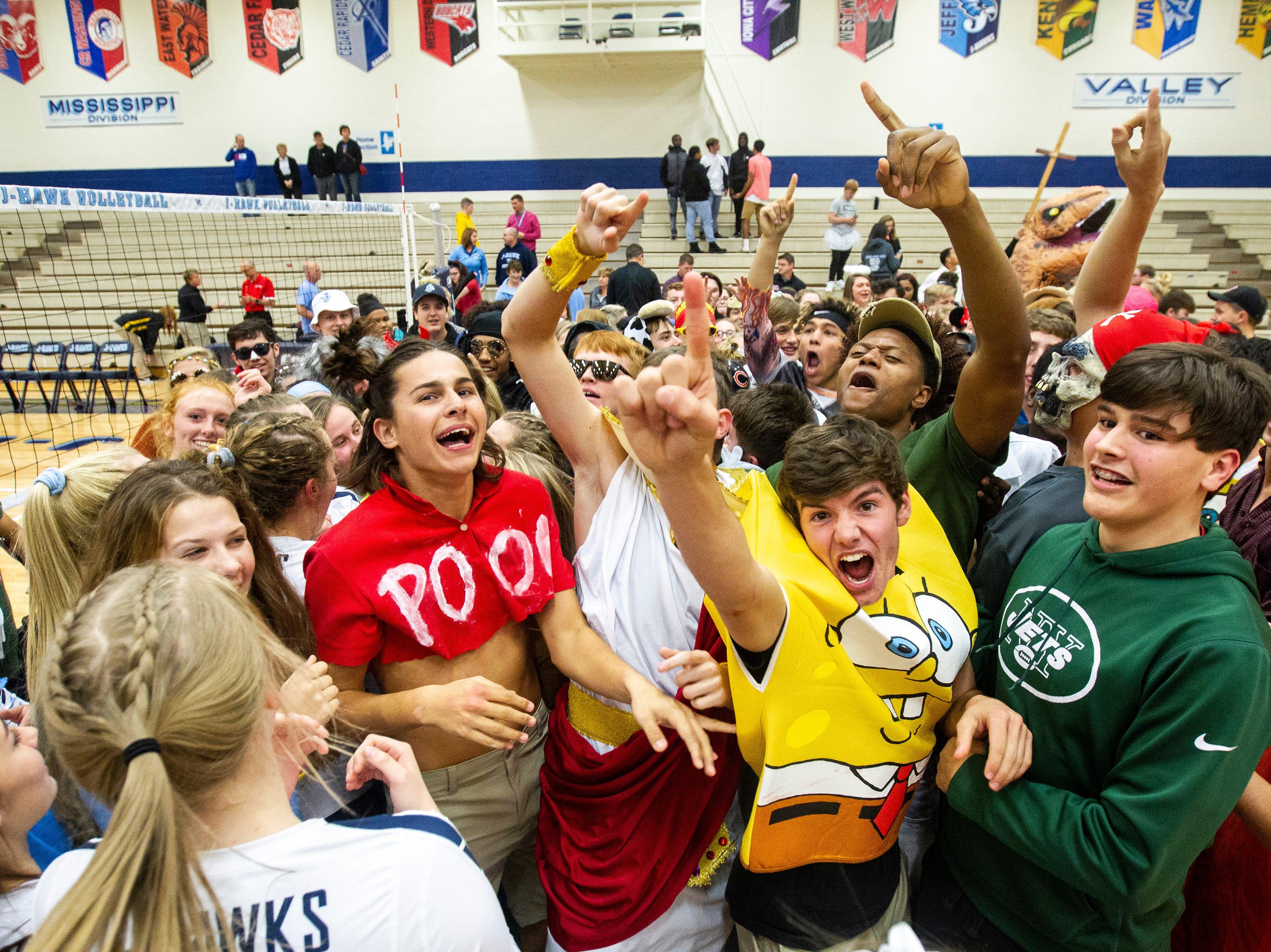 Cedar Rapids Jefferson fans celebrate after a Class 5A volleyball regional final game on Monday, Oct. 29, 2018, at Jefferson High School in Cedar Rapids.