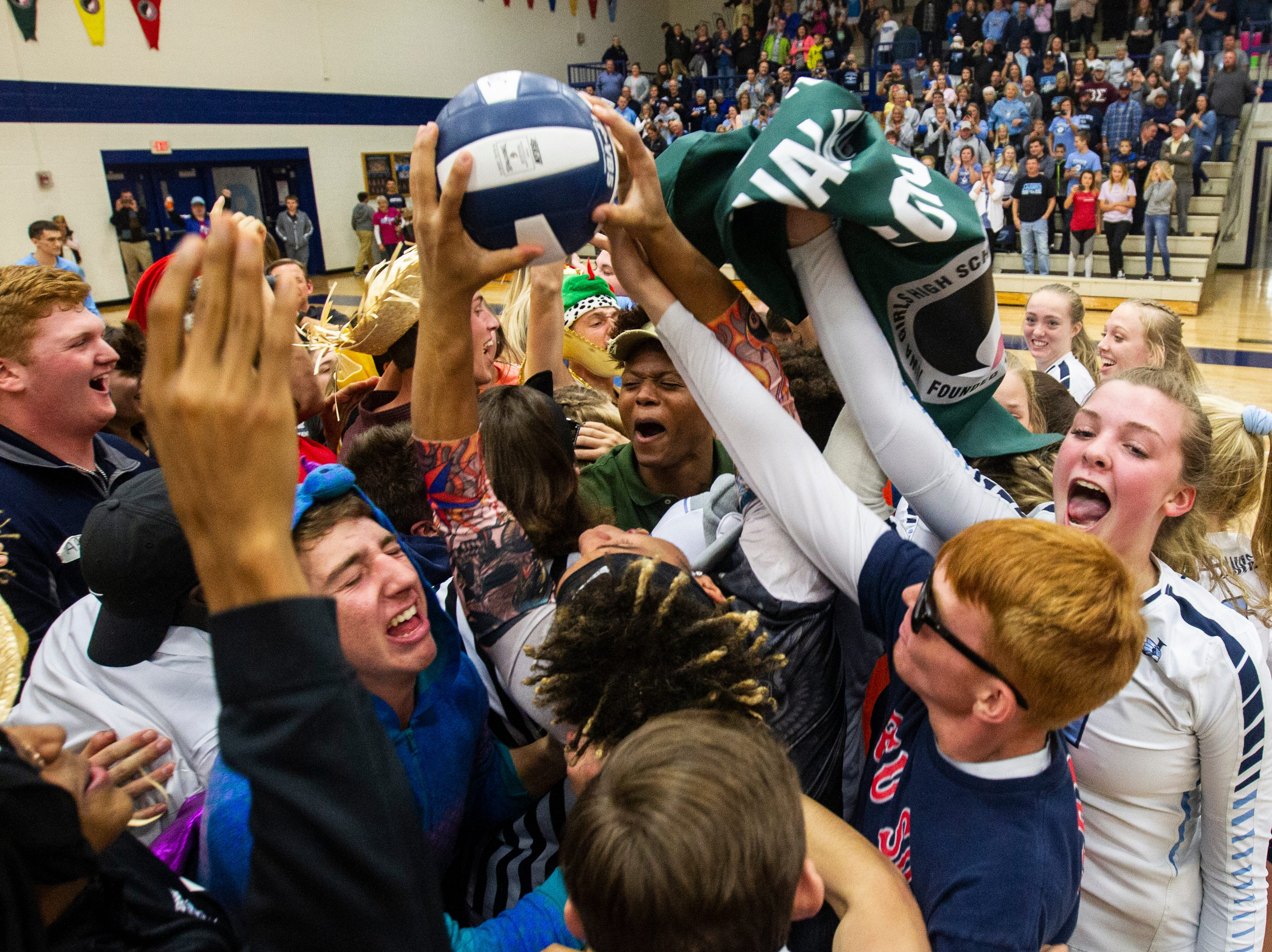 Cedar Rapids Jefferson players and fans celebrate after a regional final volleyball game Monday, Oct. 29, 2018, at Jefferson High School in Cedar Rapids.