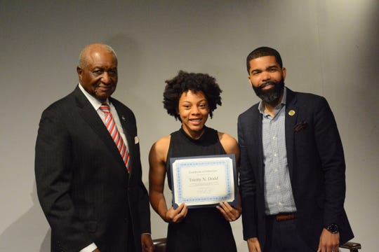 Jackson Councilman Charles Tillman, left, stands with Murrah High School tenth grader, Trinity N. Dodd and Jackson Mayor Chokwe Antar Lumumba at the mayor's Youth Council induction on Oct. 29, 2018.