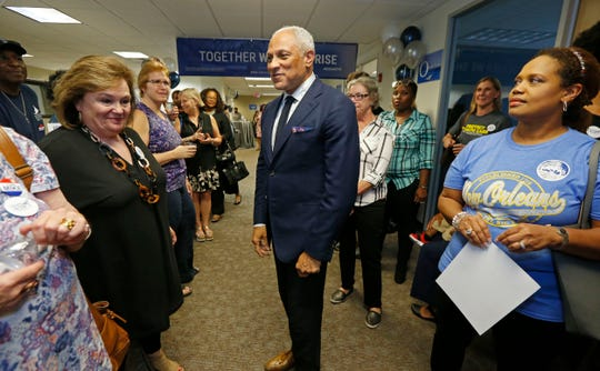 In this Sept. 7, 2018, photo, Mike Espy, a Democrat and President Bill Clinton's first agriculture secretary, speaks in Jackson, Miss., to supporters and volunteers in his campaign for November's special election to fill the unexpired term of U.S. Sen. Thad Cochran, R-Miss., who retired in April. He faces appointed Republican U.S. Sen. Cindy Hyde-Smith, R-Miss., Republican state Sen. Chris McDaniel, who almost unseated Cochran four years ago in the party's primary runoff, and Tobey Bernard Bartee, a former military intelligence officer who is also a Democrat. Party labels do not appear on the ballot. (AP Photo/Rogelio V. Solis)