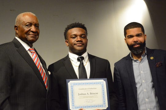 Jackson City Councilman Charles Tillman, left, stands next to Joshua Briscoe, a ninth grader at St. Joseph Catholic School, and Jackson Mayor Chokwe Antar Lumumba. Lumumba inducted Briscoe and 16 students into his Youth Council Monday night.