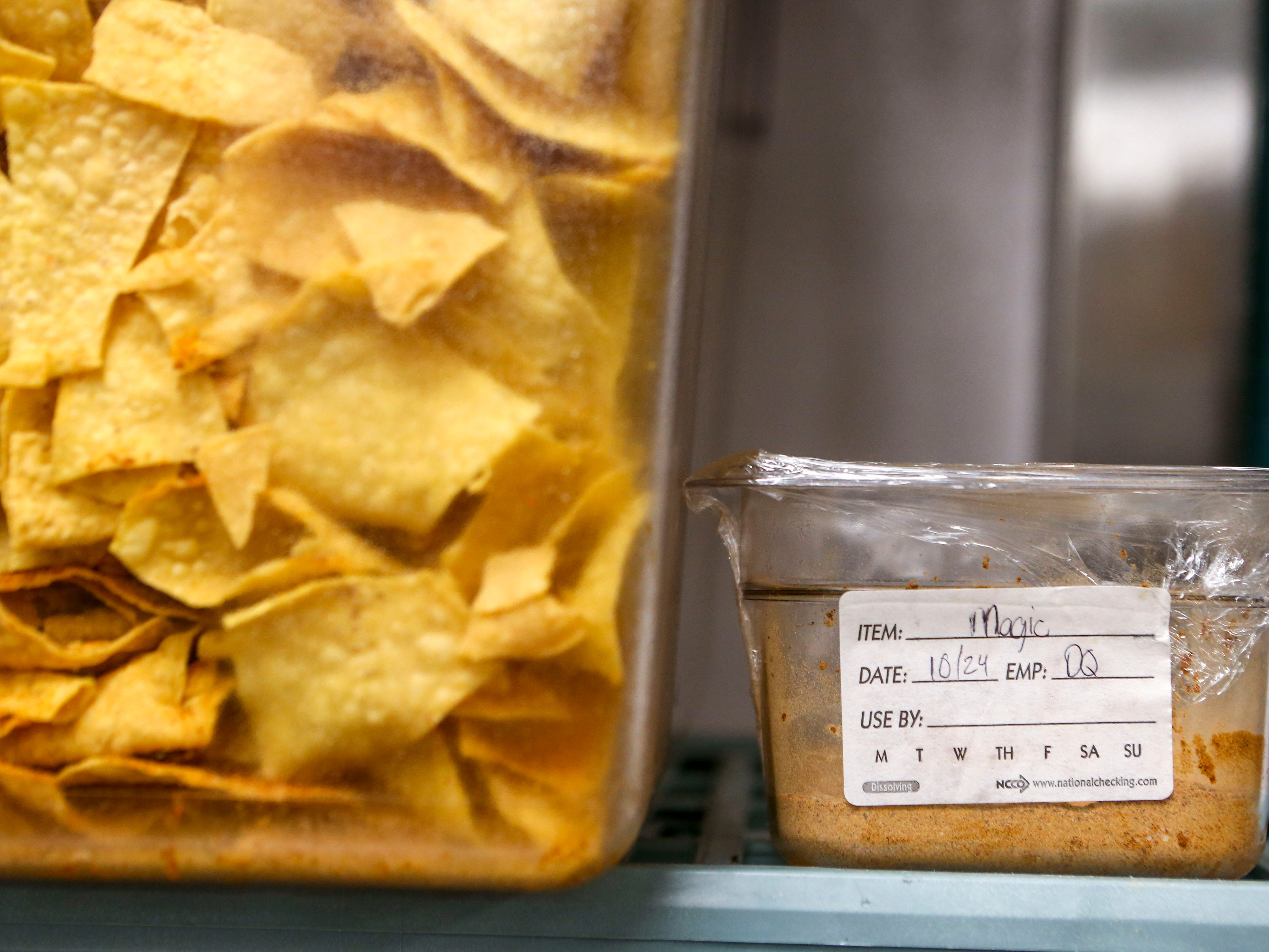"""""""Magic"""" seasoning sits on the shelf next to tubs of chips during the soft opening at Tacos 4 Life, a new restaurant in Jackson, Tenn., on Monday, Oct. 29, 2018."""