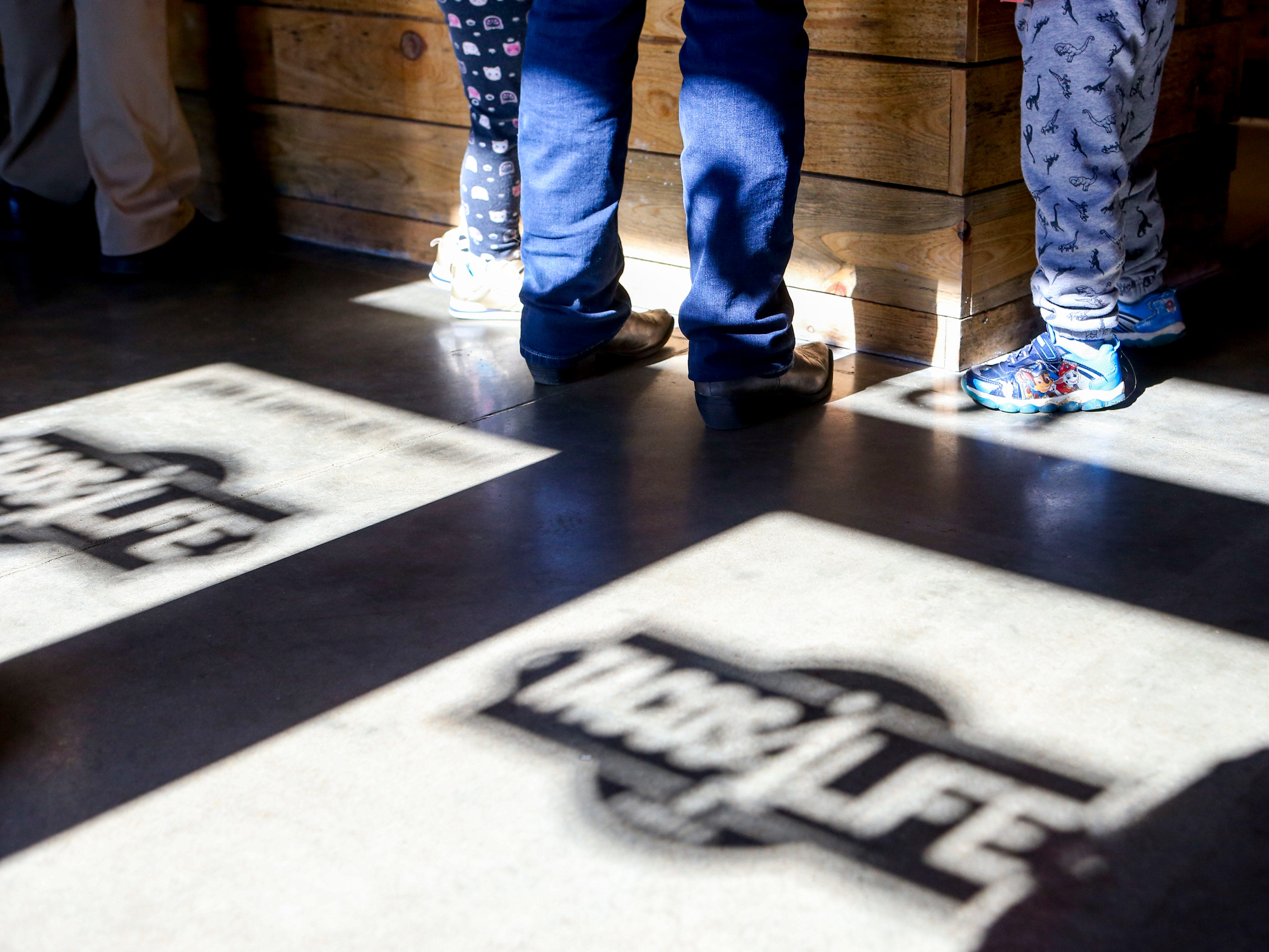 A family orders meals at the register during the soft opening at Tacos 4 Life, a new restaurant in Jackson, Tenn., on Monday, Oct. 29, 2018.