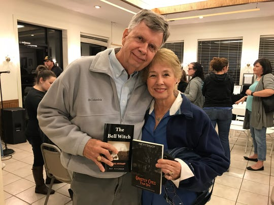 Bell family descendant Lucy Butler and her husband Larry Butler hold their copies of two of Pat Fitzhugh's books after attending a Bell Witch storytelling at the Delta Heritage Center in Brownsville, Tenn. on Oct. 26.