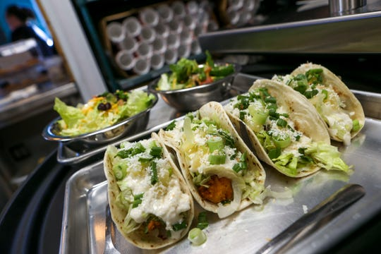 Prepared tacos sit ready for delivery in the window during the soft opening at Tacos 4 Life, a new restaurant in Jackson, Tenn., on Monday, Oct. 29, 2018.