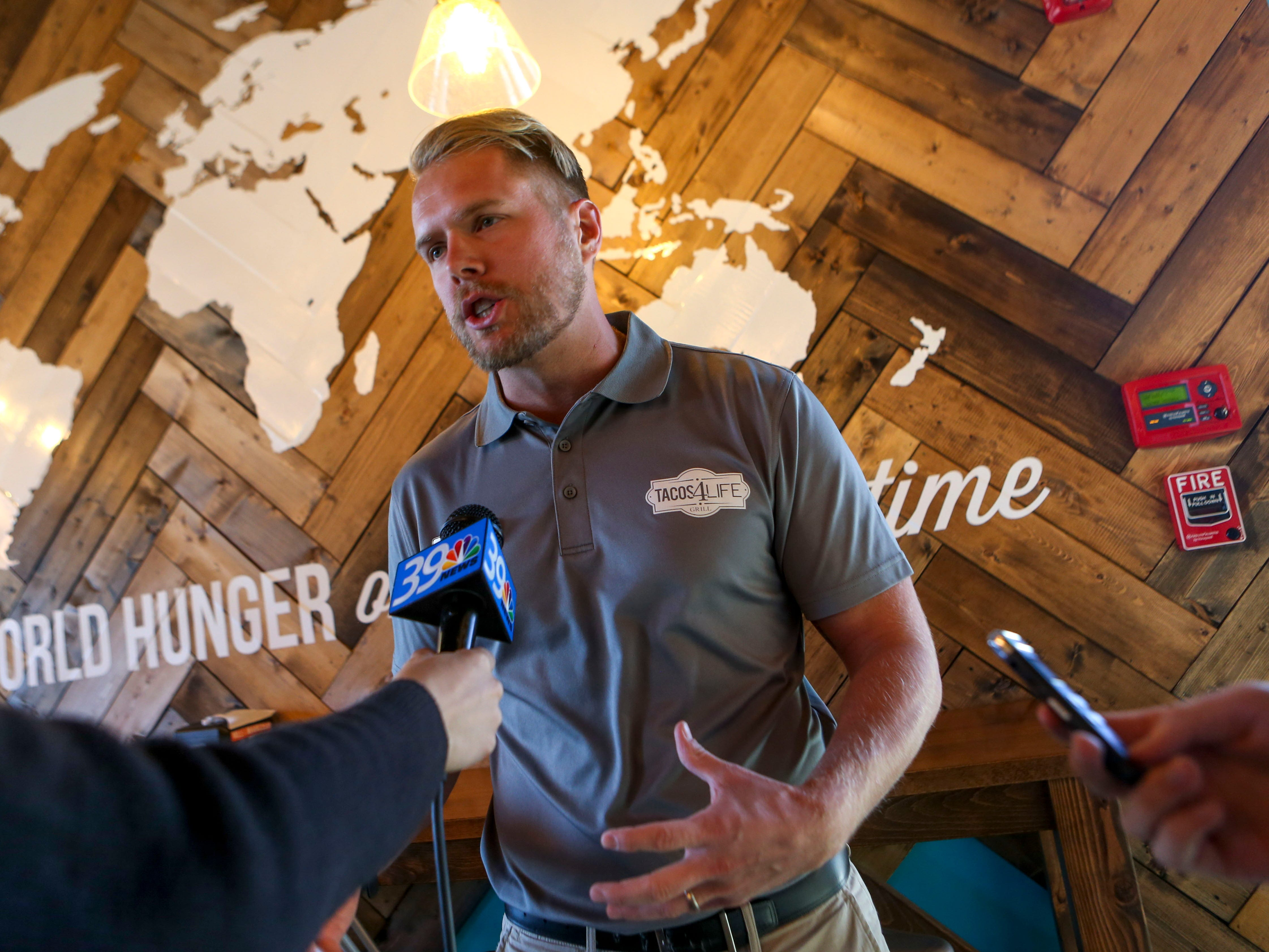 Austin Samuelson founder of Tacos 4 Life, speaks to reporters during the soft opening at Tacos 4 Life, a new restaurant in Jackson, Tenn., on Monday, Oct. 29, 2018.