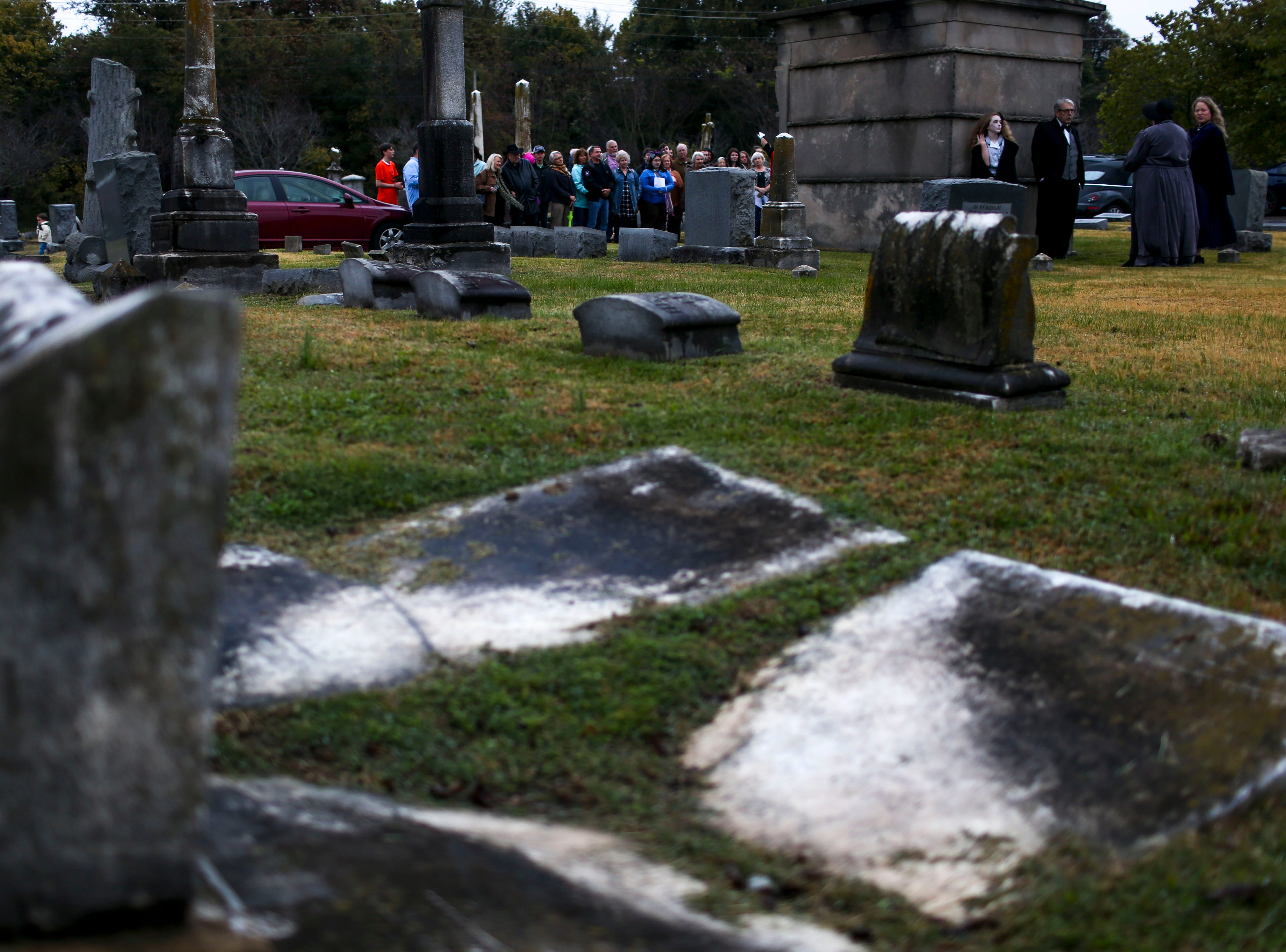 A crowd gathers to listen to monologues at a mausoleum during Ghost Walk tour at Riverside Cemetery in Jackson, Tenn., on Friday, Oct. 26, 2018.