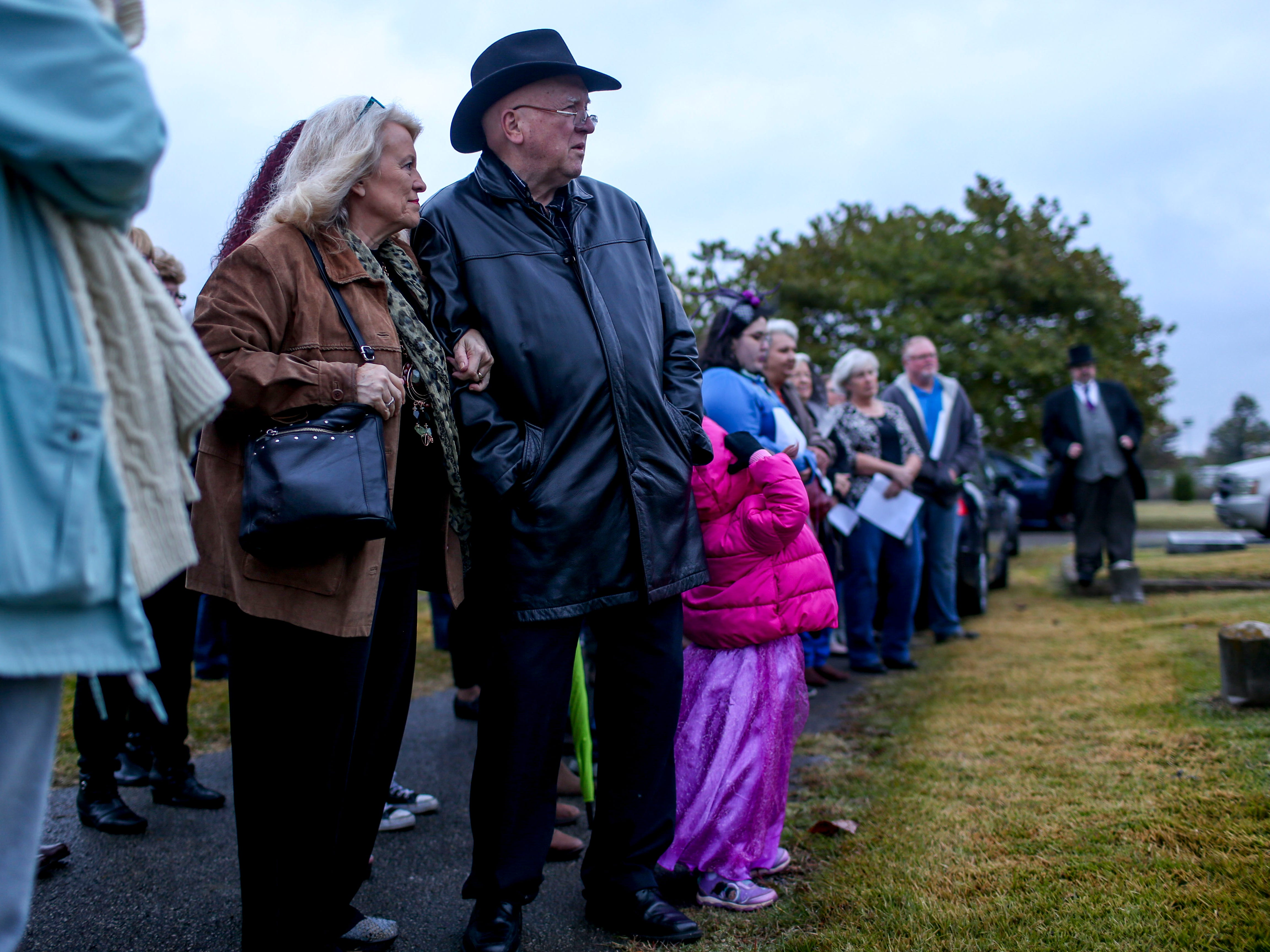 Visitors listen to monologues from people presenting from the perspective of different historical figures during Ghost Walk tour at Riverside Cemetery in Jackson, Tenn., on Friday, Oct. 26, 2018.