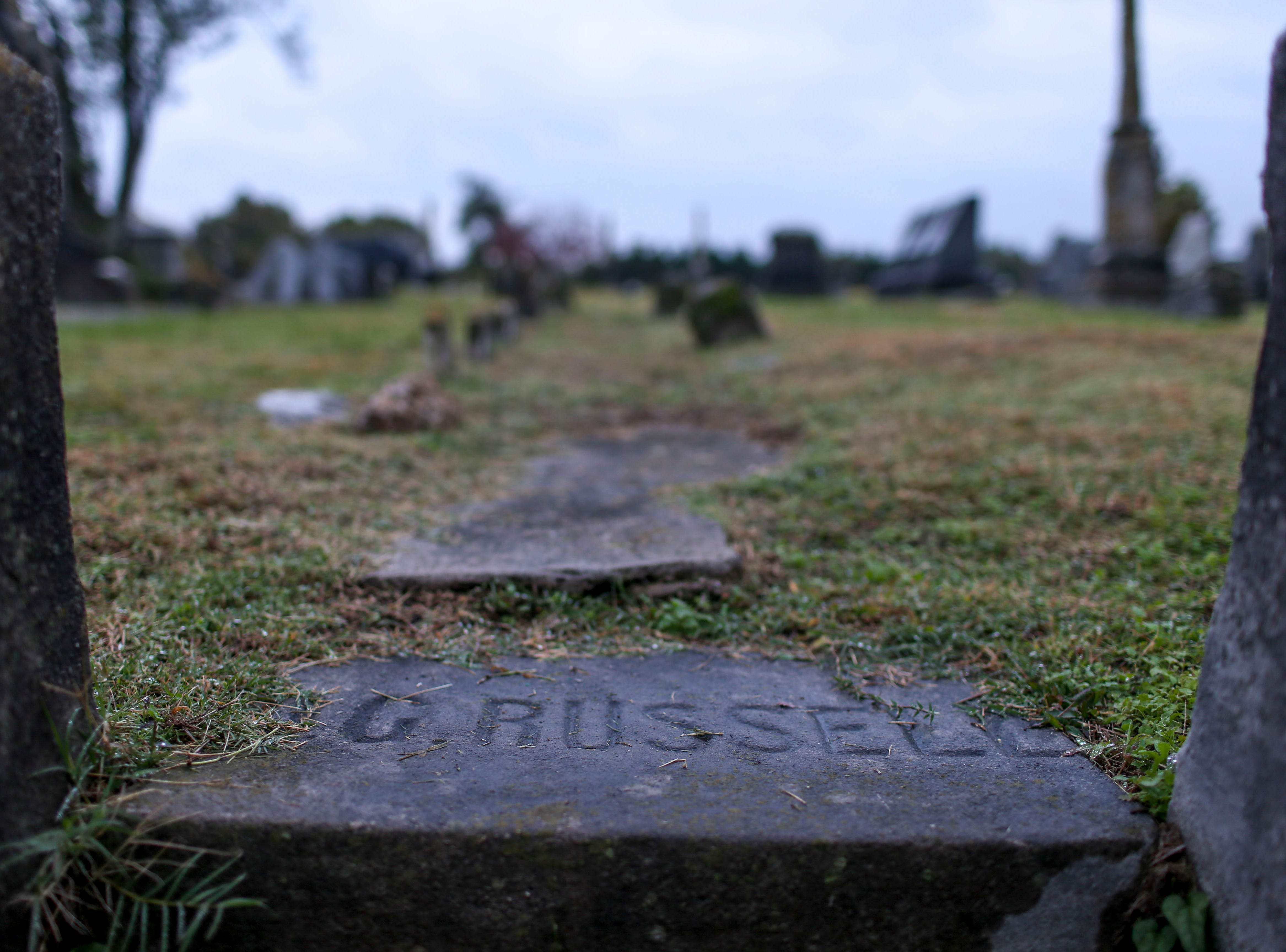 An etched stone acts as a stair step to part of the cemetery during Ghost Walk tour at Riverside Cemetery in Jackson, Tenn., on Friday, Oct. 26, 2018.