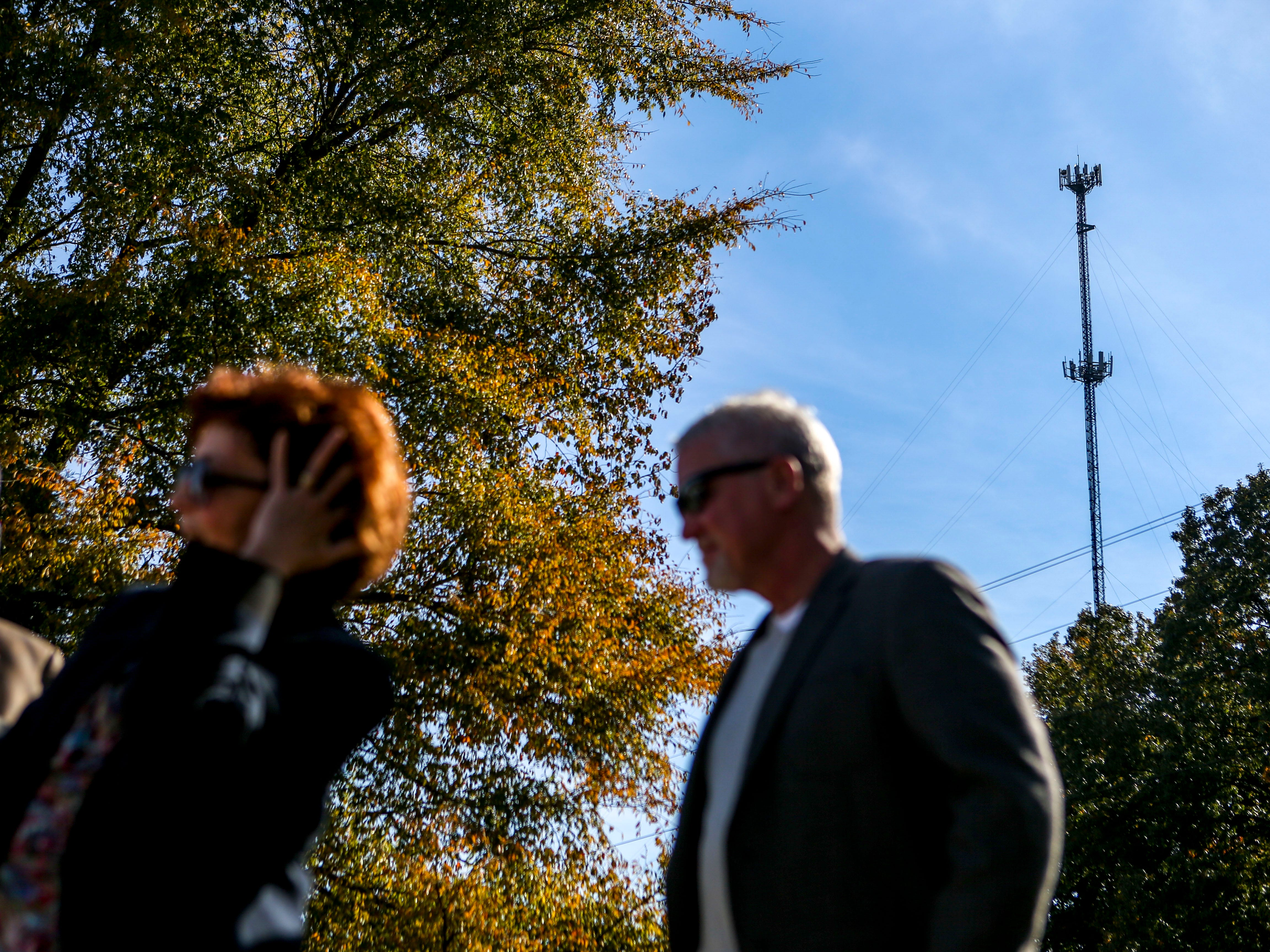 An AT&T cellular tower looms in the distance during a ceremonial opening for the expansion of wireless broadband coverage through AT&T cell towers at 4567 Brownsville Hwy in Denmark, Tenn., on Tuesday, Oct. 30, 2018.