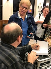 Bell family descendant Lucy Butler talks with author and Bell Witch historian Pat Fitzhugh as he signs her book after a storytelling at the Delta Heritage Center in Brownsville, Tenn. on Oct. 26.