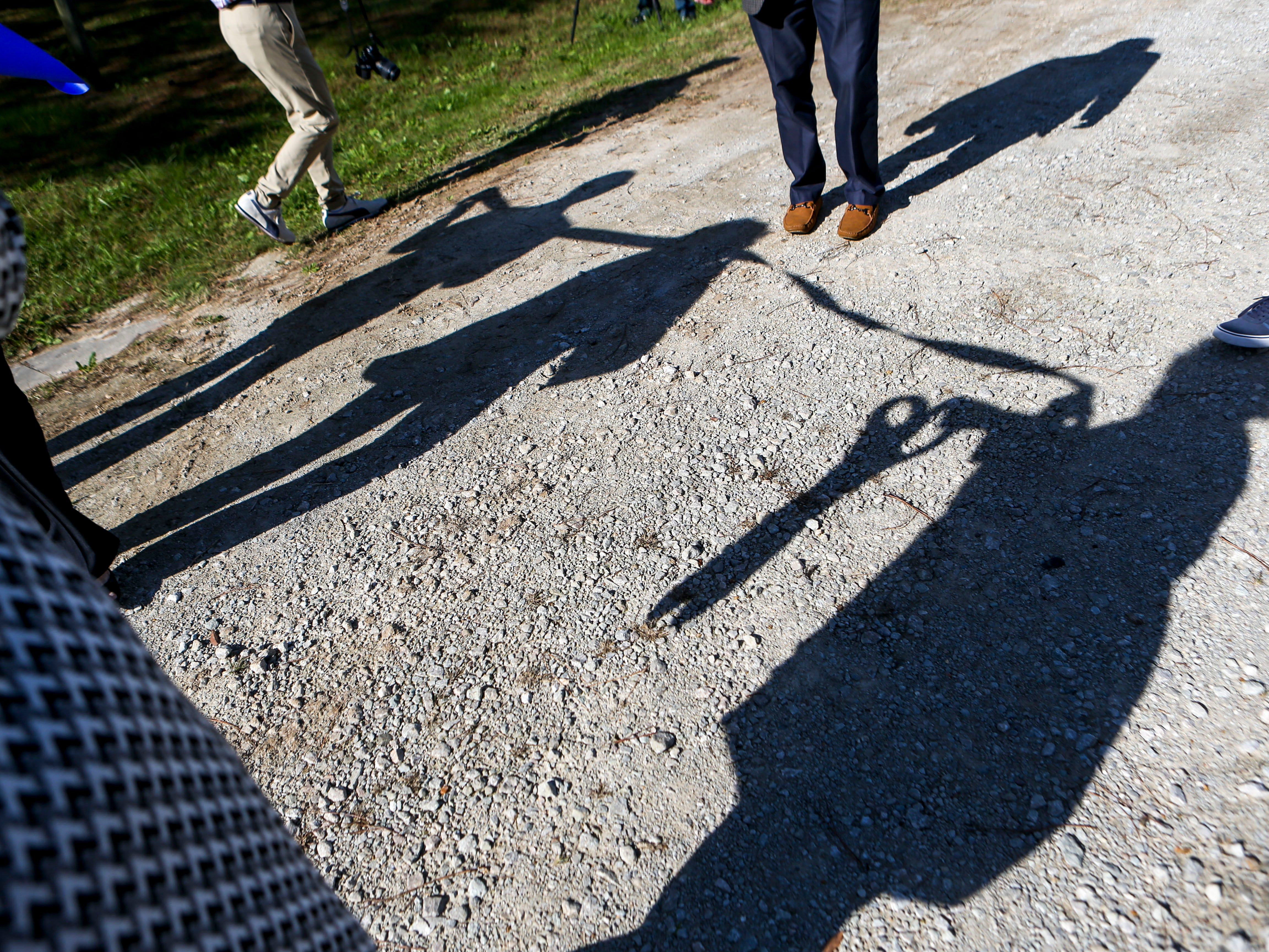 Visitors stretch out a roll of ribbon that will be cut during a ceremonial opening for the expansion of wireless broadband coverage through AT&T cell towers at 4567 Brownsville Hwy in Denmark, Tenn., on Tuesday, Oct. 30, 2018.
