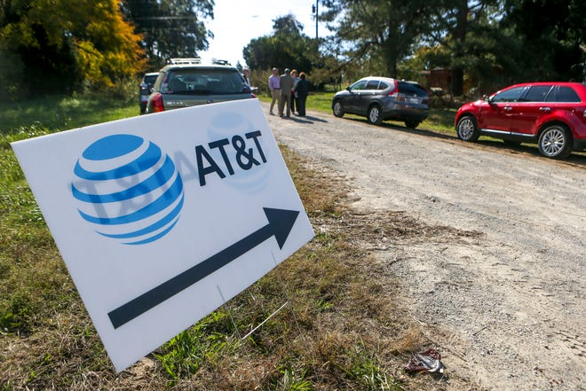 A sign points towards a meeting area during a ceremonial opening for the expansion of wireless broadband coverage through AT&T cell towers at 4567 Brownsville Hwy in Denmark, Tenn., on Tuesday, Oct. 30, 2018.
