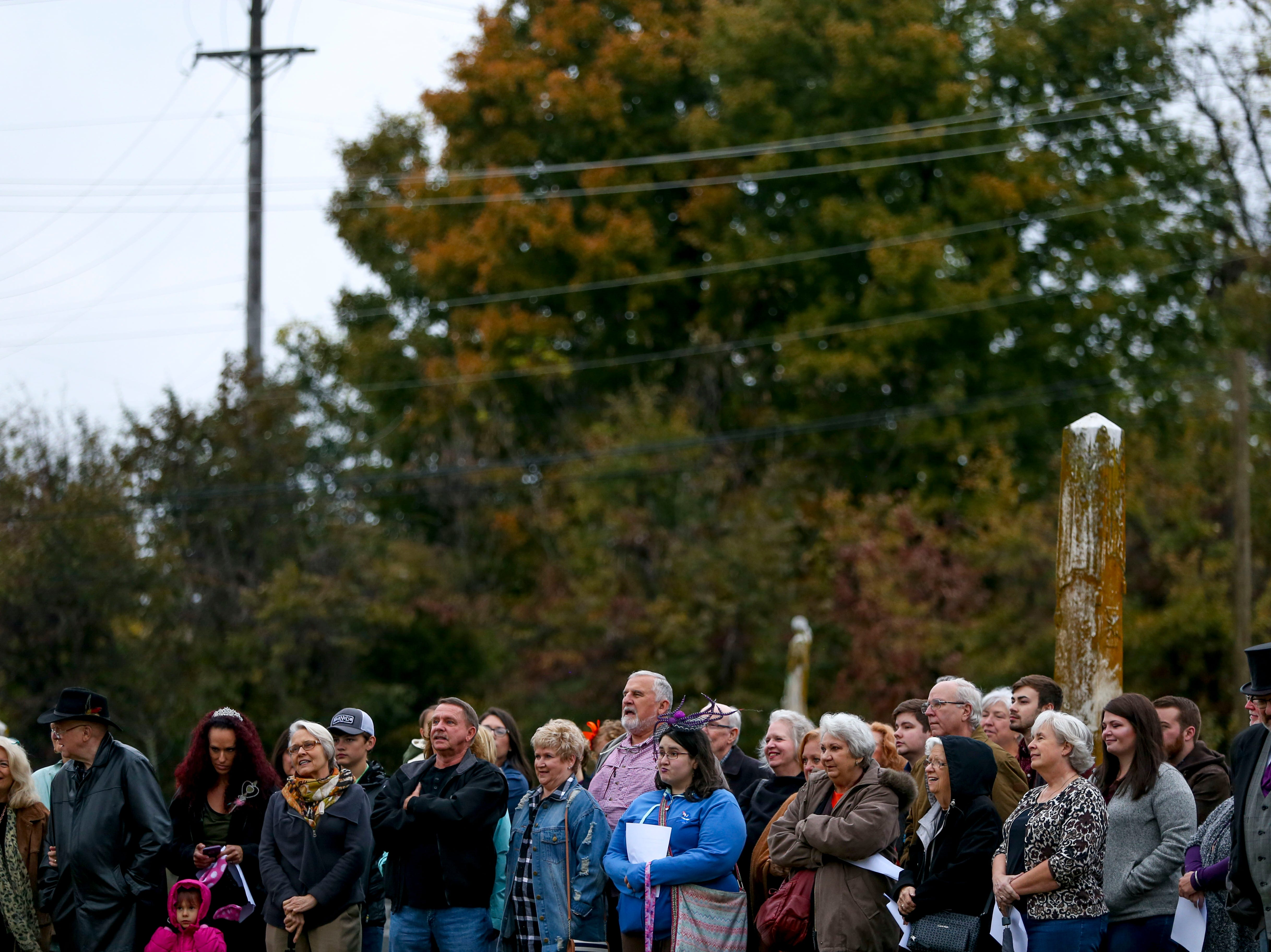 Visitors line up and listen to monologues from historic figures at a mausoleum during Ghost Walk tour at Riverside Cemetery in Jackson, Tenn., on Friday, Oct. 26, 2018.