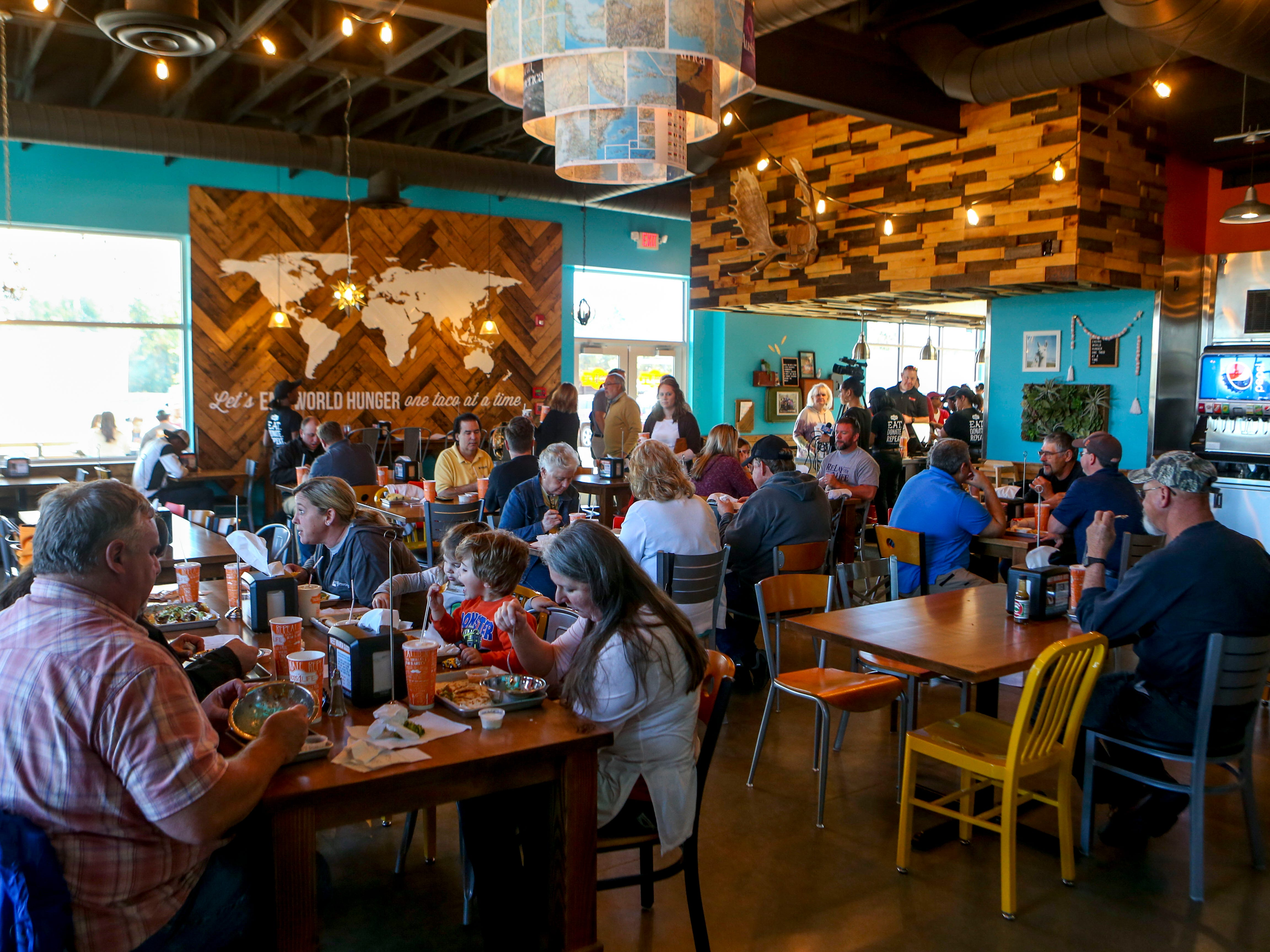 Patrons dine in the main room during the soft opening at Tacos 4 Life, a new restaurant in Jackson, Tenn., on Monday, Oct. 29, 2018.