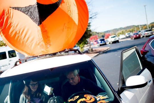 David Weech gives News Sentinel reporter Brenna McDermott a tour of his Halloween-themed Kia Soul during a visit to the Knoxville News Sentinel in Knoxville, Tennessee on Tuesday, October 30, 2018. Weech drives his themed car for Uber and Lyft.