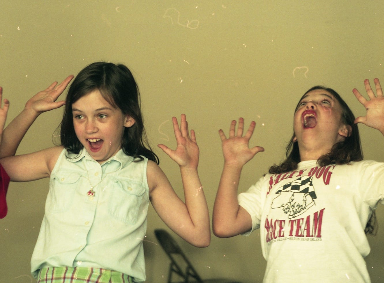 Surprised Lacey Reynolds, 10, left, and Audrey Christiansen, 8, practice various facial expressions in their Theatre for Young People beginning mime camp on June 4, 1997 at the Bijou Theatre. The camp is part of the drama camp which hosts various workshops for three age groups ranging from five-year-olds to teens.