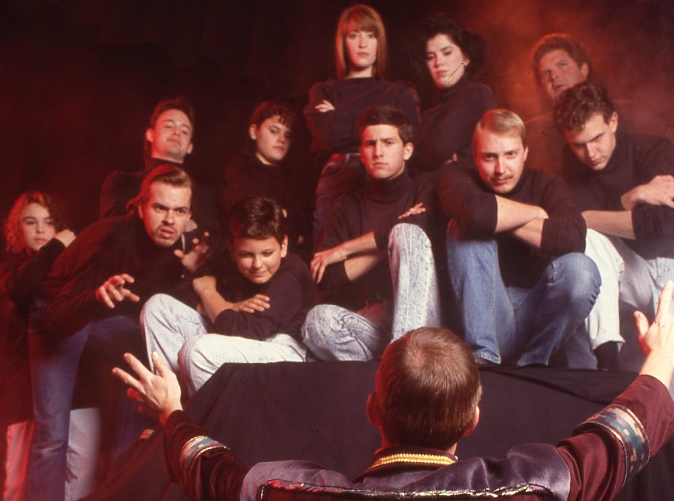 A group poses for a photo at the Bijou Theatre on November 25, 1990,