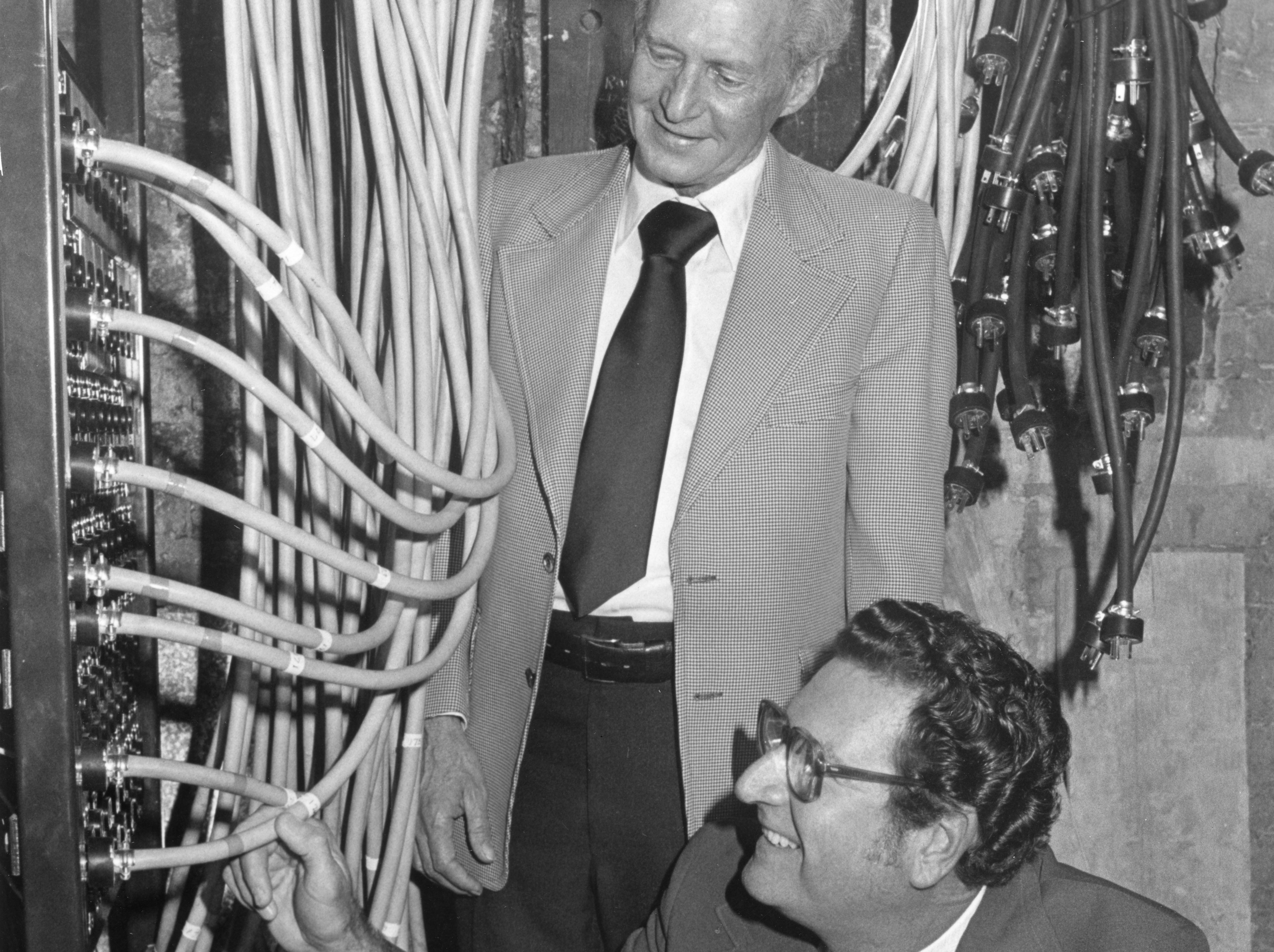 George Beets (standing), president of the Knoxville Building and Construction Trades Council, and Joh Walker, council treasurer, inspect the wiring for the intricate lighting system backstage at the renovated Bijou Theatre ahead of the grand opening on October 27, 1977.