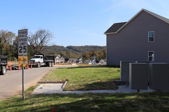 Residents either walk or drive up a hill to claim their mail, after the USPS requested developers use cluster mailboxes rather than traditional ones.