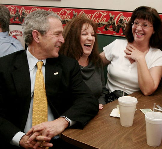 President George W. Bush visits with patrons of Porkers Bar-B-Que restaurant Wednesday, Feb. 21, 2007 in Chattanooga, Tenn., where President Bush stopped by for lunch after attending a forum on health care initiatives at the Chattanooga Convention Center.