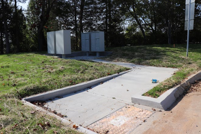 Developers need to install pathways and other associated projects so that residents can get their mail at cluster mailboxes. The one at the Emory Brooke subdivision was only recently built.