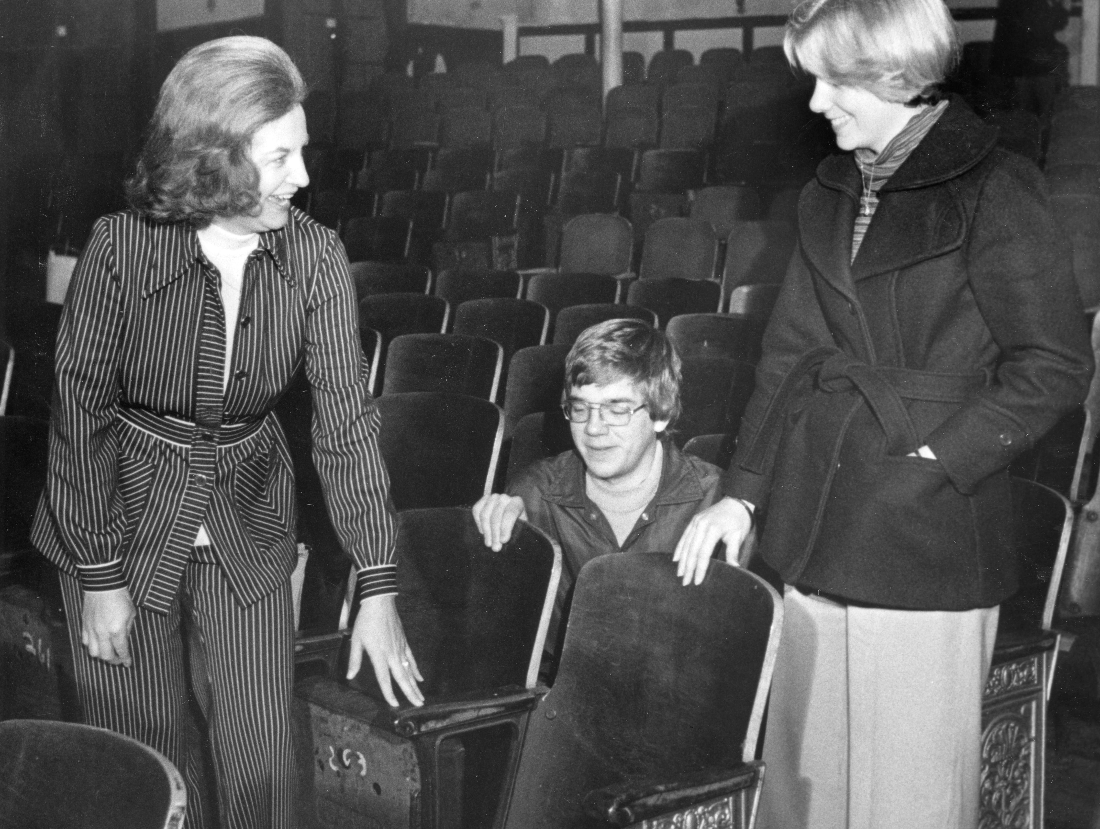 Mary Gifford, Jim Burns and Sue Rufus inspect the new seats at the newly renovated Bijou Theatre on December 13, 1976.