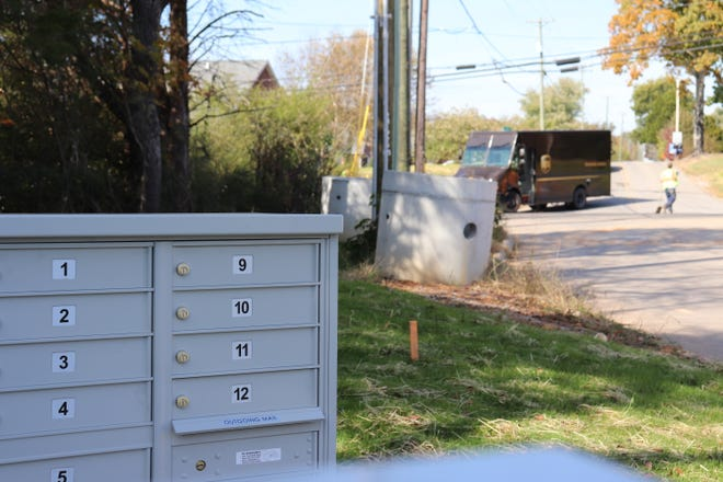 A UPS truck drives past a subdivision with cluster mailboxes on Oct. 30, 2018.